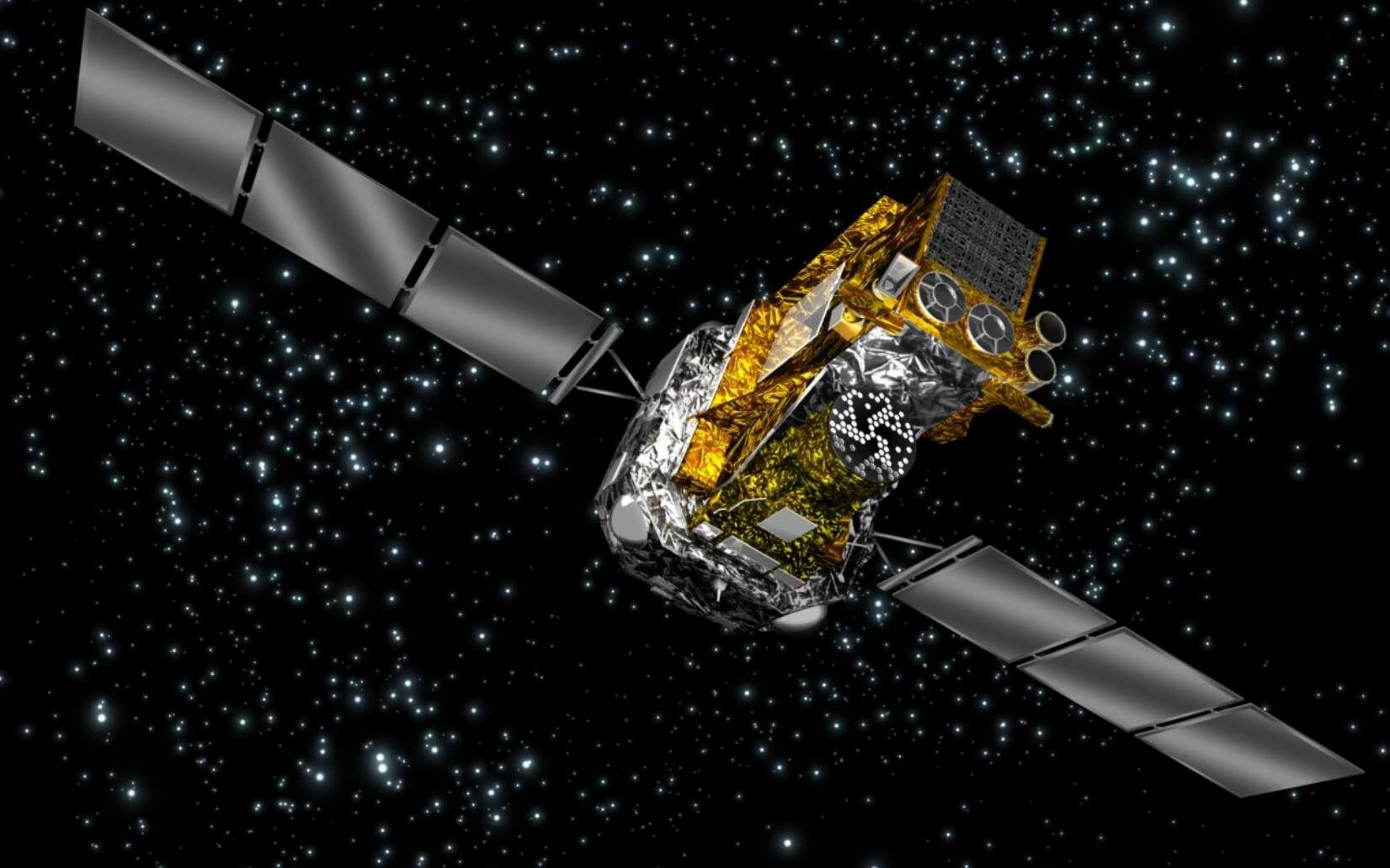 Une vue d'artiste du INTErnational Gamma-Ray Astrophysics Laboratory (Integral) observant un sursaut gamma sur la voûte céleste. © Esa 2002, illustration par Medialab