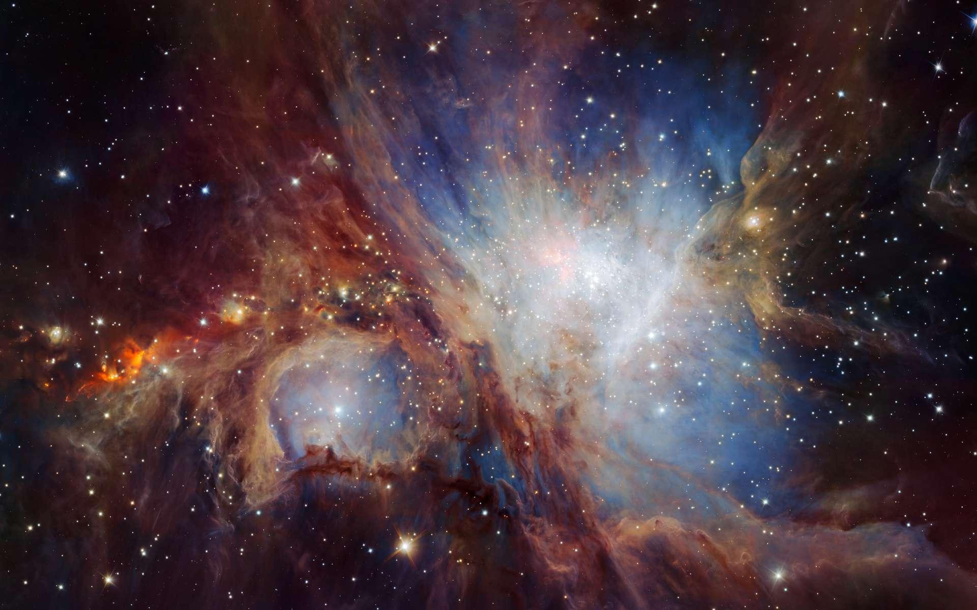 Cette superbe image de la région de formation stellaire de la nébuleuse d'Orion (M 42) résulte de la superposition de multiples clichés acquis par la caméra infrarouge Hawk-1 installée sur le VLT. Elle offre la vue la plus profonde à ce jour de cette région du ciel et révèle un nombre insoupçonné d'objets de masse planétaire faiblement lumineux. © Eso, H. Drass et al.