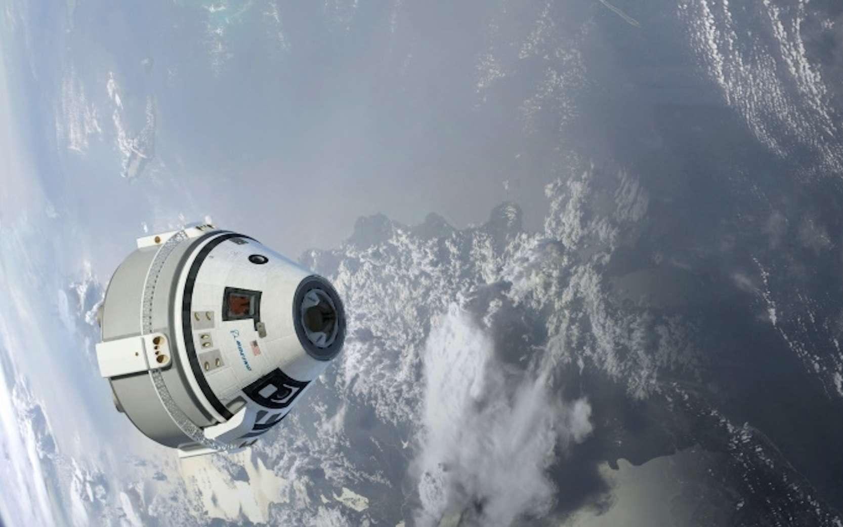La capsule Starliner en orbite autour de la Terre, fournie par Boeing en 2015. © HO, Nasa, Boeing, AFP