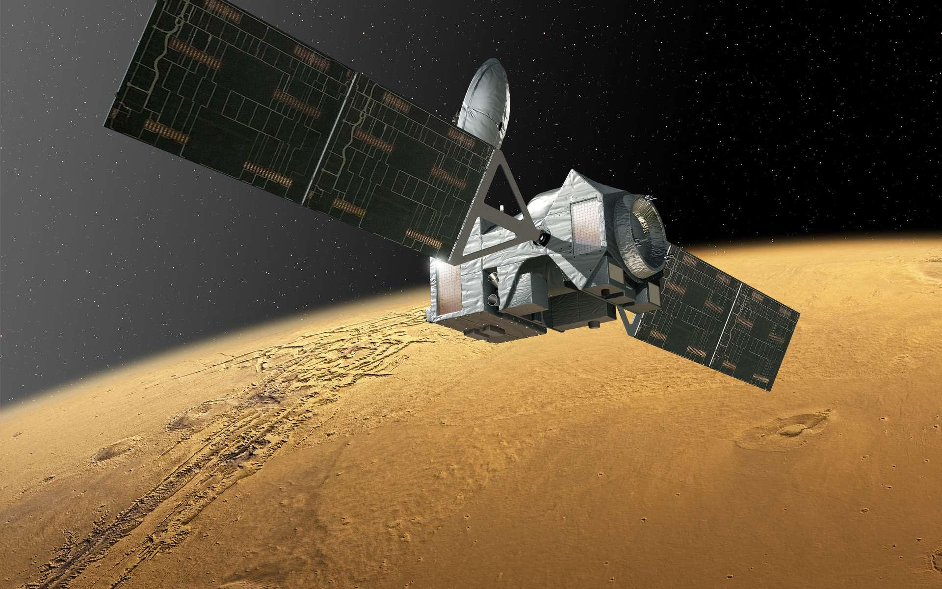 La sonde TGO, en vue d'artiste, sur son orbite elliptique autour de Mars. Avec ses instruments très précis, l'engin étudiera la chimie de l'atmosphère martienne, dont celle, mystérieuse, du méthane. © ESA