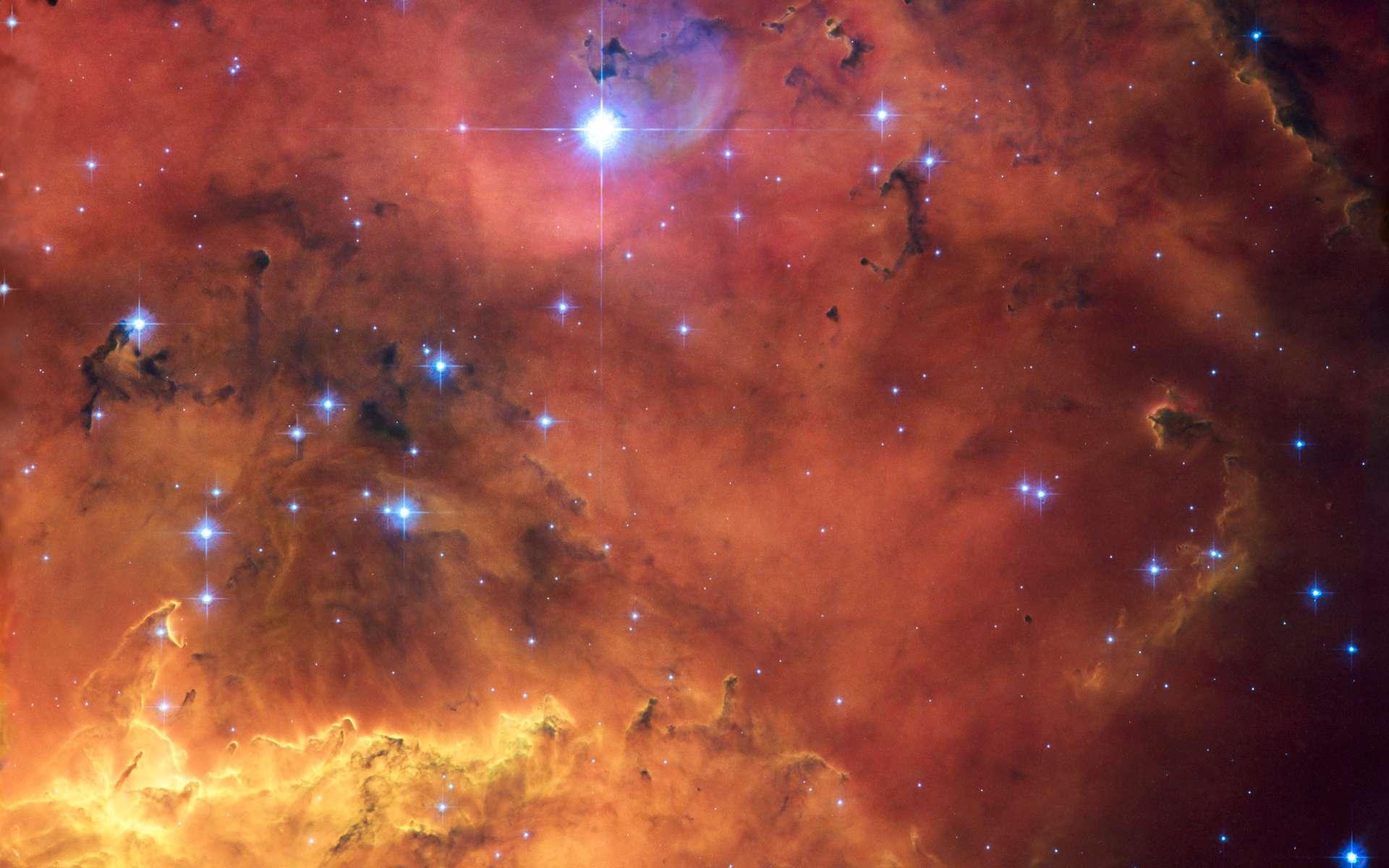 NGC 2467, une pouponnière d'étoiles, située à 13.000 années-lumière et visible au sein de la constellation de la Poupe, donc dans le ciel de l'hémisphère sud. Crédits Nasa, Esa & Orsola De Marco (Macquarie University)