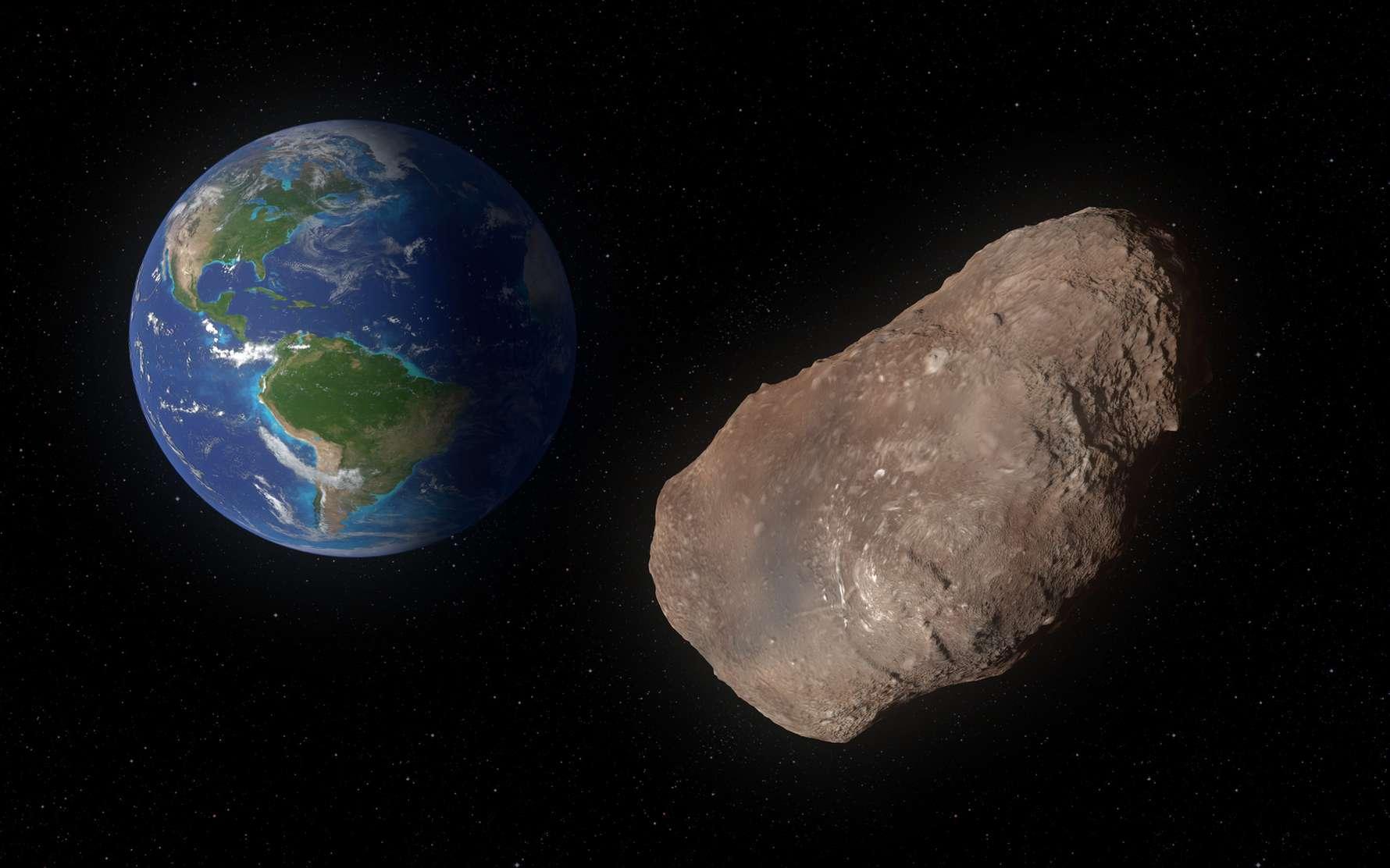 Un astéroïde d'environ 1 km va passer près de la Terre le 4 février. Ici, illustration de l'astéroïde 2002 AJ129 frôlant la Terre. © ordus, Fotolia