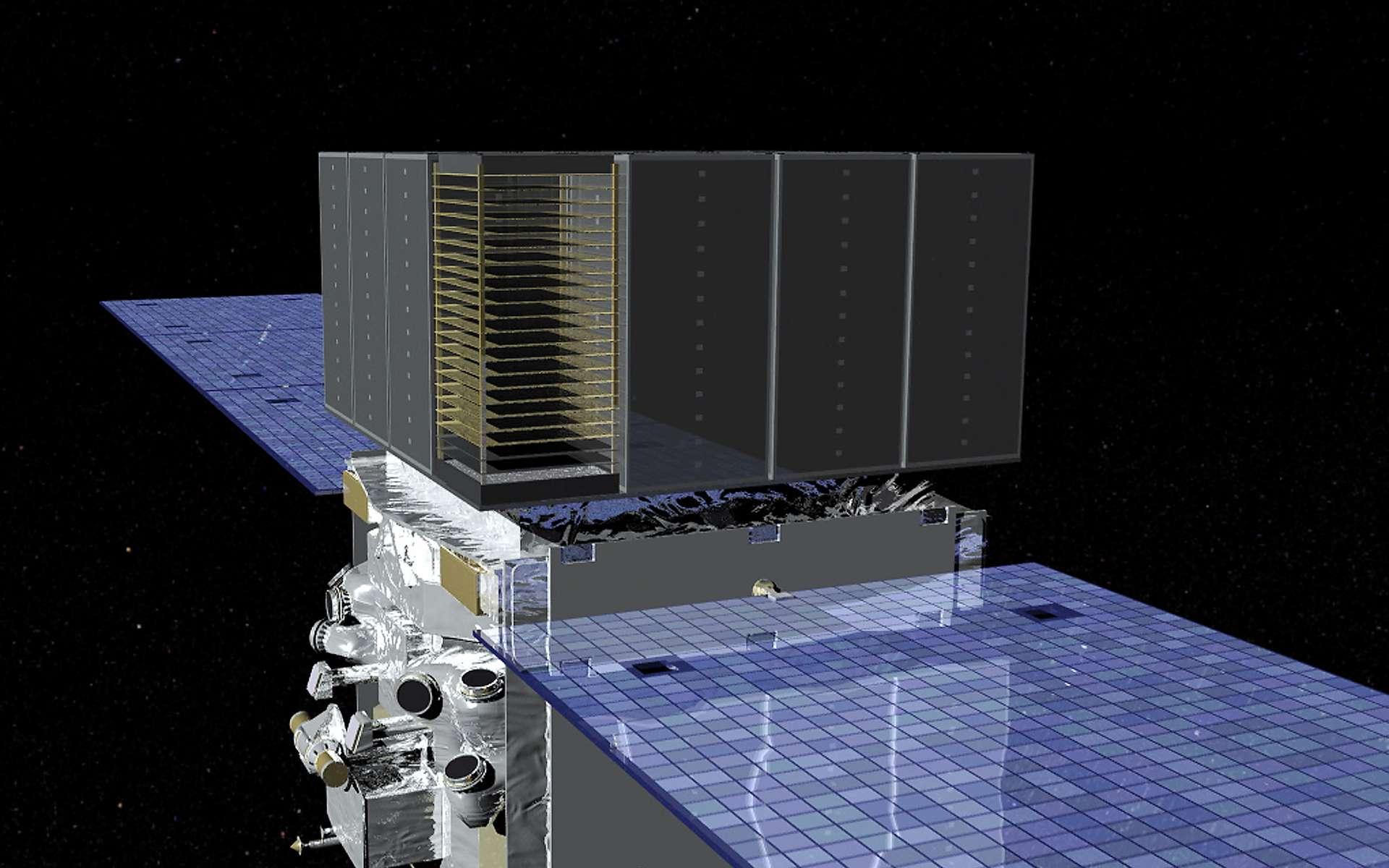 Le Large Area Telescope (LAT) de Fermi (la série de plaques au-dessus des paneaux solaires sur l'illustration) détecte les rayons gamma qui, le traversant, produisent de la matière (électrons) et de l'antimatière (positrons) après avoir heurter des couches de tungstène. Crédit : Nasa/Goddard Space Flight Center Conceptual Image Lab