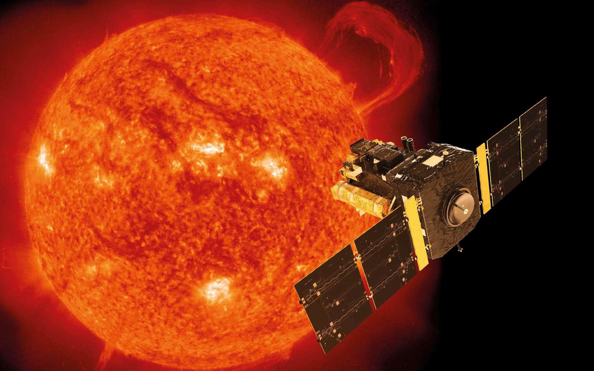 Le cœur du Soleil tourne 4 fois plus vite que sa surface. Ici, une illustration de Soho superposée à une image de notre étoile prise par le satellite le 14 septembre 1999 avec l'instrument EIT (Extreme-ultraviolet Imaging Telescope). Ce jour-là, une gigantesque protubérance en forme de poignet se développait sur le limbe du Soleil. Le pic d'activité du cycle 23 allait alors débuter. © Soho, ESA, Nasa, ATG medialab