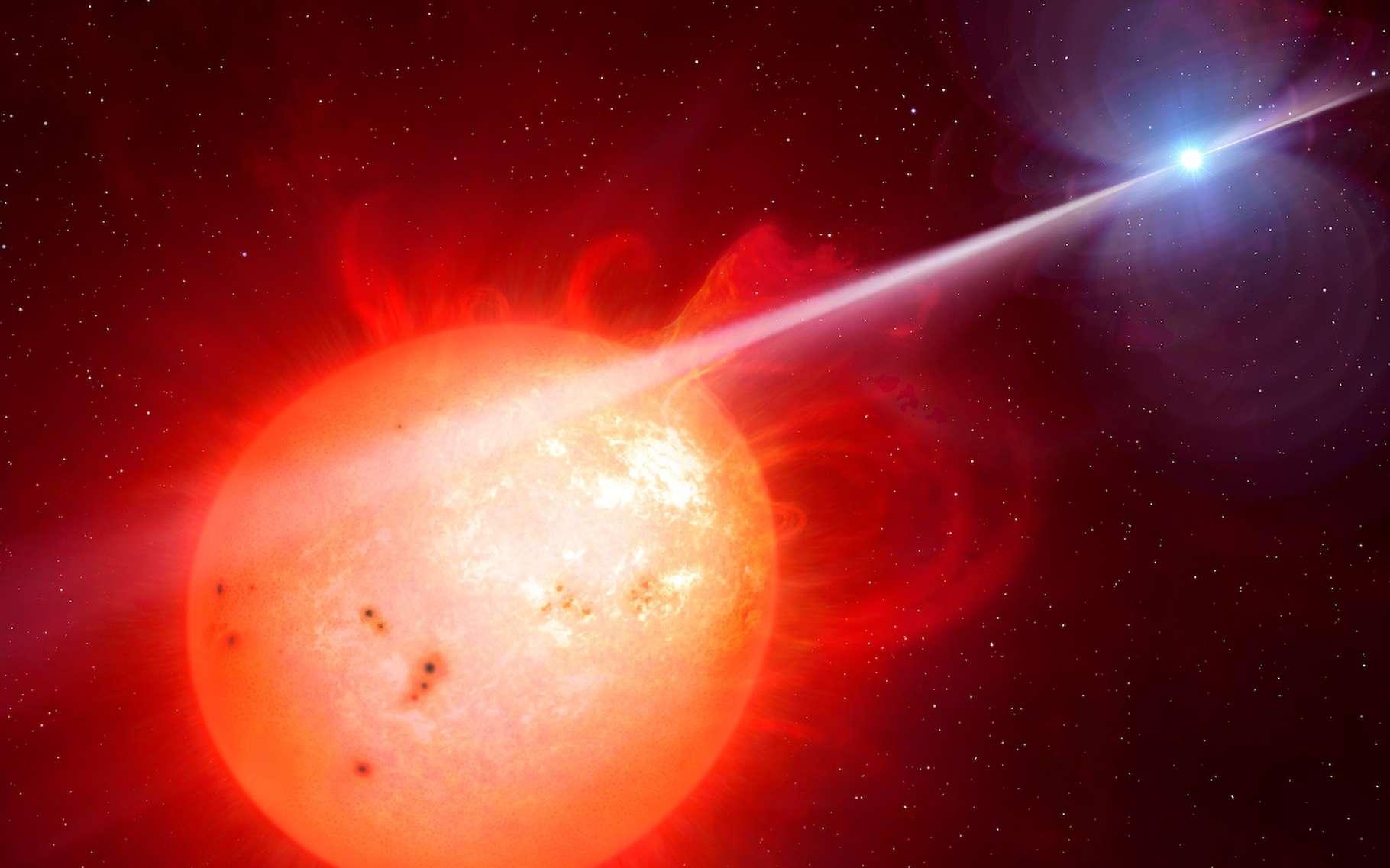 Cette vue d'artiste montre l'étrange système d'étoile double AR Scorpii. Une naine blanche (à droite), en rotation rapide, accélère les électrons jusqu'à une vitesse proche de celle de la lumière. Ces particules libèrent alors un rayonnement en faisceau qui touche l'étoile compagnon, une naine rouge (à gauche), avec un rythme de 1,97 minute. Le résultat est l'émission d'un rayonnement s'étendant de l'ultraviolet au domaine radio. © M. Garlick, University of Warwick, Eso