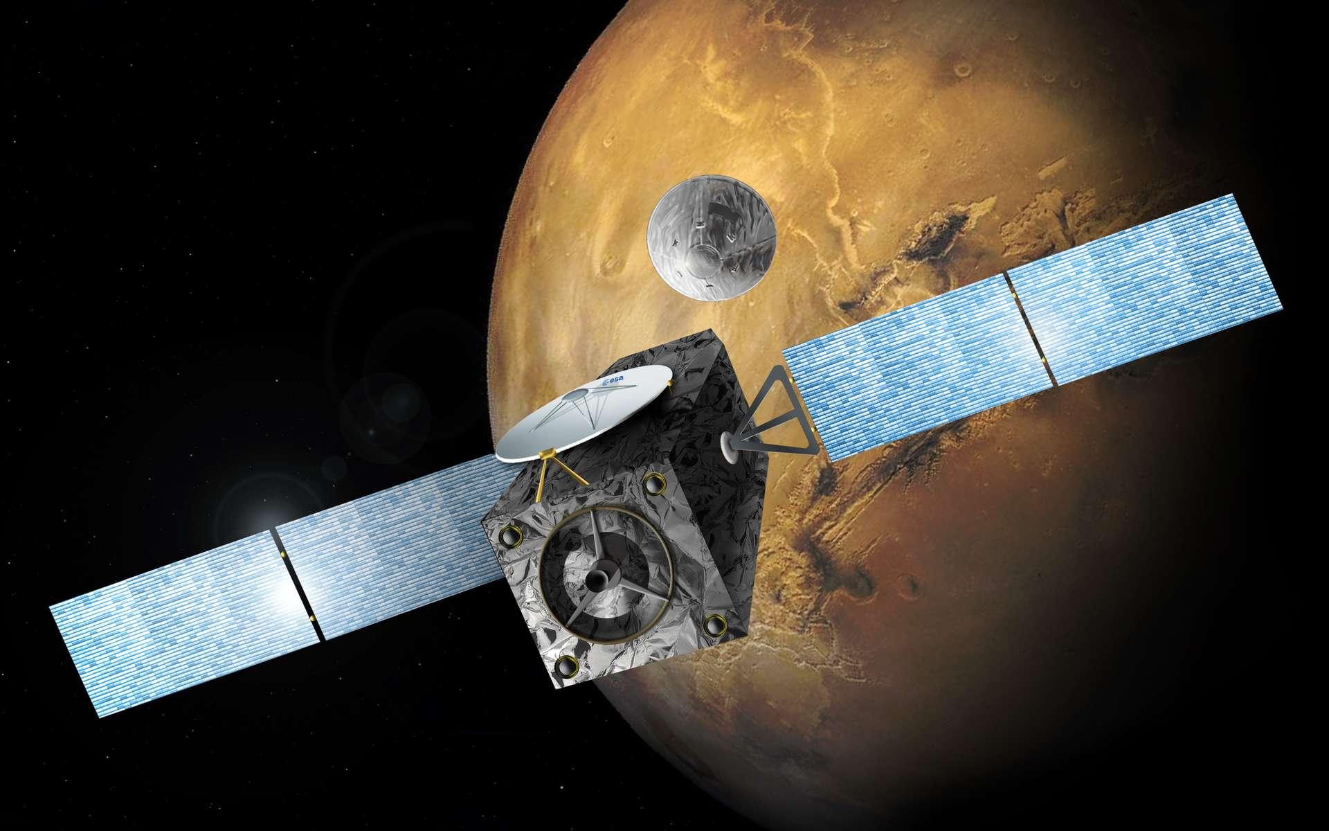 Vue d'artiste de l'orbiteur TGO arrivant près de Mars et libérant le module d'atterrissage Schiaparelli, de la mission ExoMars. © Esa