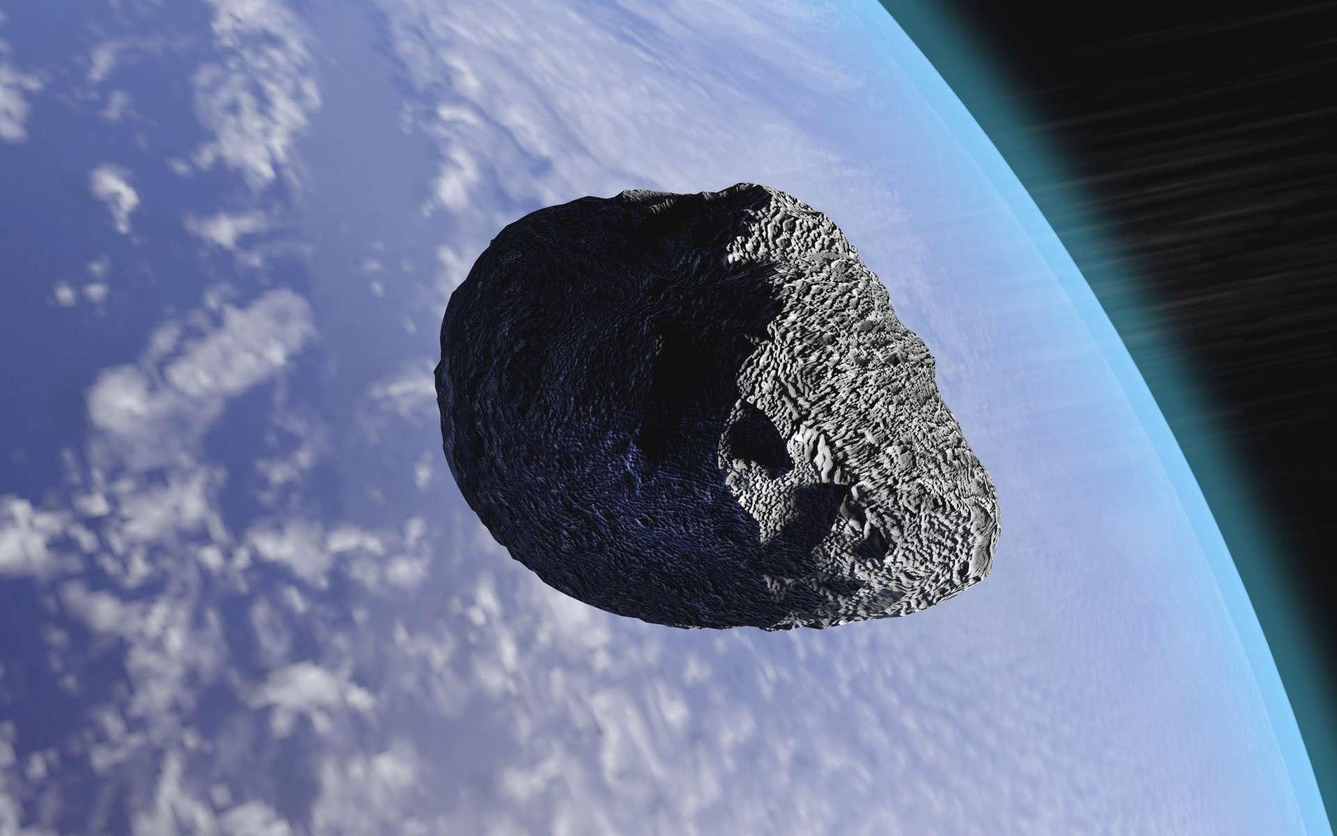 Illustration d'un astéroïde passant à proximité de la Terre. © auntspray, fotolia