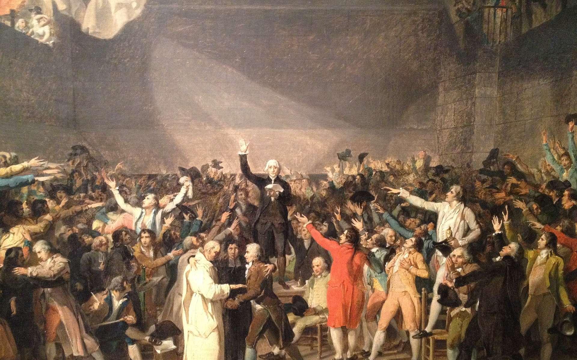 Le 20 juin 1789, des députés prononcent le serment du Jeu de paume et promettent de ne pas se séparer avant qu'une Constitution ne soit adoptée. © Jacques-Louis David, Wikimedia Commons, Domaine public