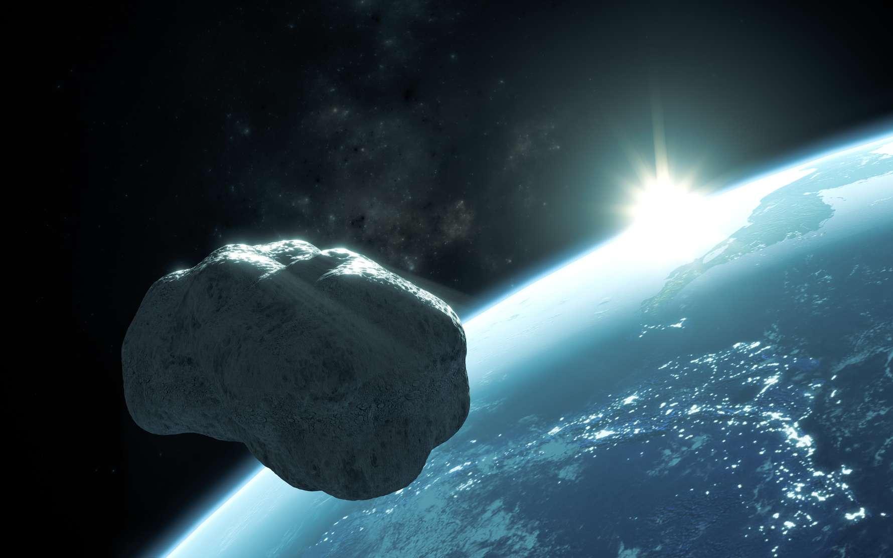 Illustration d'un astéroïde passant près de la Terre. © S. Masclaux, fotolia