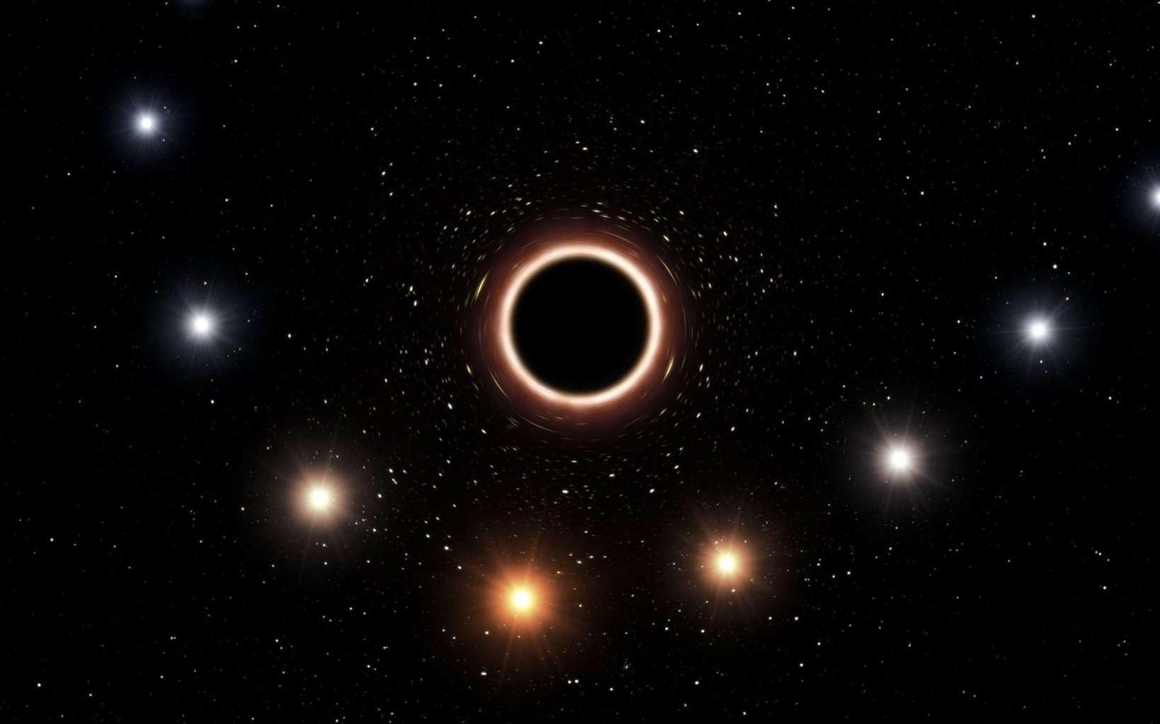 Sur cette vue d'artiste figure la trajectoire de l'étoile S2 passant à proximité du trou noir supermassif situé au centre de la Voie lactée. À mesure qu'elle s'approche du trou noir, l'étoile arbore une couleur toujours plus rougeâtre. Cet effet, prédit par la théorie de la relativité générale d'Einstein, résulte de la présence d'un champ gravitationnel très intense. Sur ce graphe, le rougissement ainsi que la taille des objets ont été volontairement exagérés. © ESO/M. Kornmesser