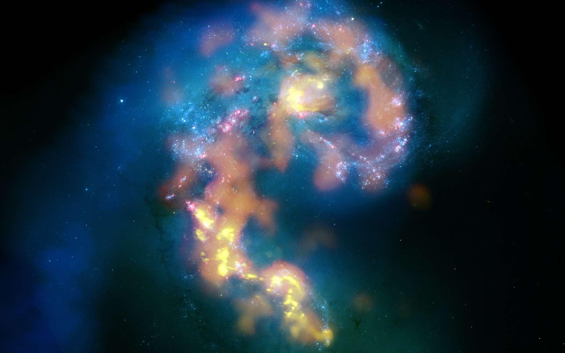 Cette image de la galaxie des Antennes est une mosaïque qui combine deux types d'images prises dans trois longueurs d'onde différentes par Hubble, dans le visible et Alma, dans le millimétrique et submillimétrique. Les données Alma (orange et jaune) montrent les nuages de gaz froid très denses, lieux de naissance des étoiles. © B. Saxton, (NRAO/AUI/NSF); Alma (ESO/NAOJ/NRAO); HST (Nasa, Esa, et B. Whitmore (STScI); J. Hibbard, (NRAO/AUI/NSF)