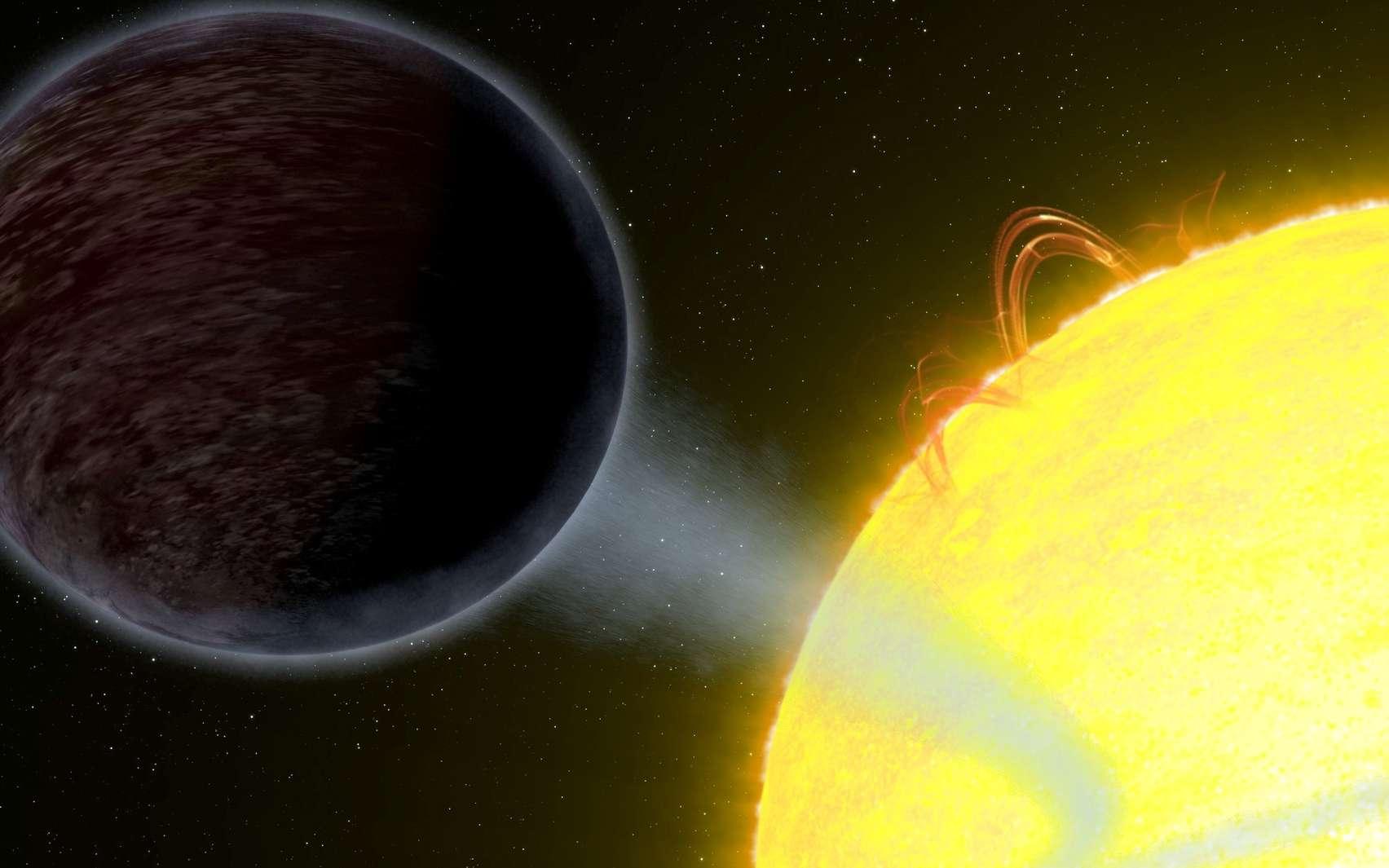 La planète Wasp 12b est noire sur cette image d'artiste. Elle orbite si près de son étoile que cette Jupiter chaude perd de la matière du fait des forces de marée. Le courant gazeux qui s'en échappe forme un filament bleuté autour de Wasp 12a, l'étoile hôte. © Nasa, ESA, G. Bacon (STScI)