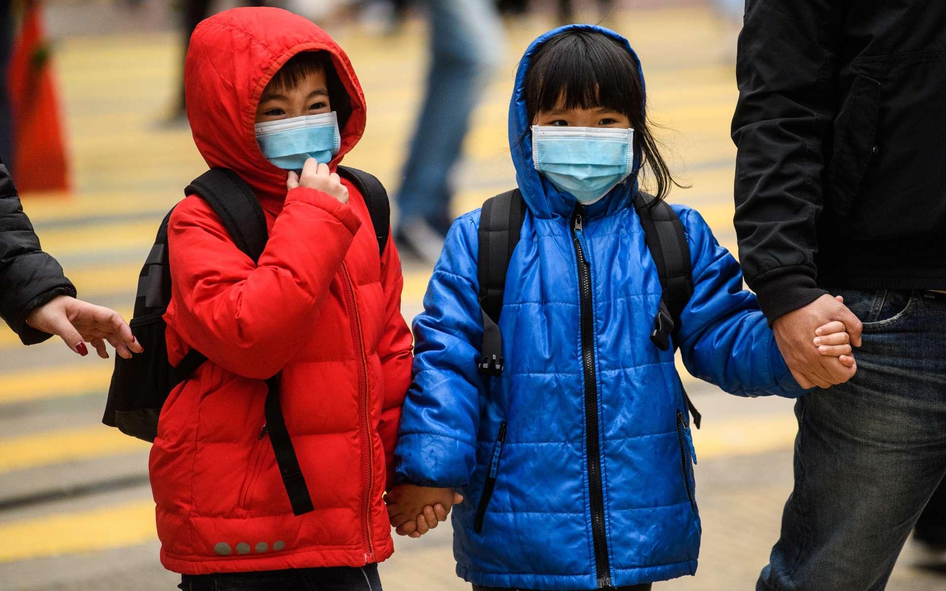 La Chine prend des mesures de confinement dans de nouvelles villes chinoises plus loin de l'épicentre du virus. © Anthony Wallace, AFP