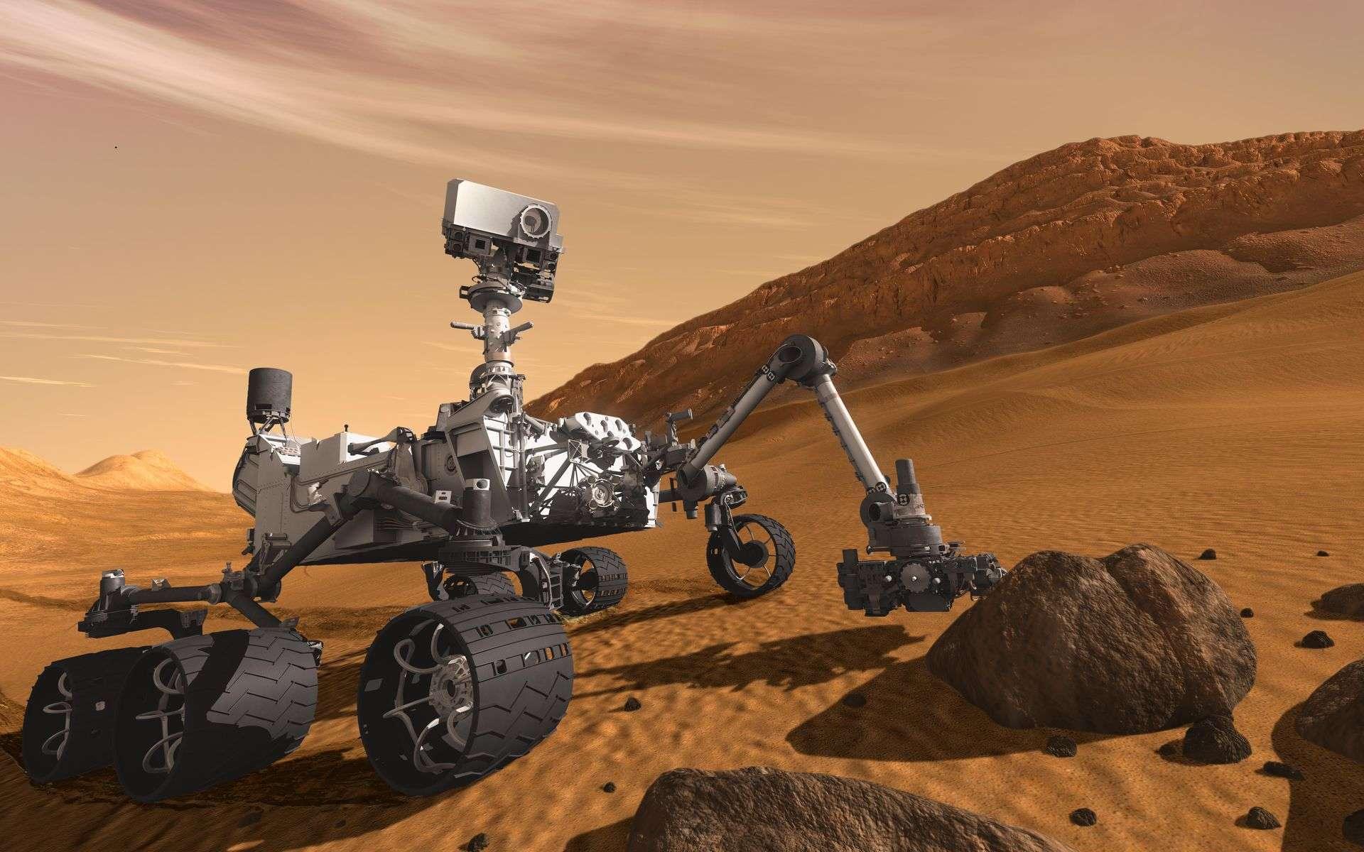 Le rover Curiosity, dessiné sur son terrain de chasse, dans le cratère Gale, où il travaille depuis maintenant cinq ans. © Nasa, JPL