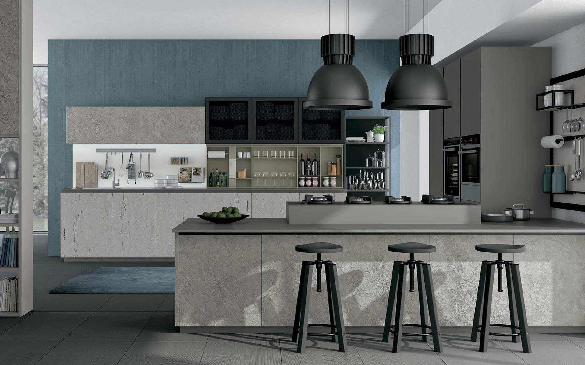 Des cloches Led au-dessus d'un comptoir en épi ou d'un îlot, un must dans une cuisine de style atelier industriel. © Les cuisines d'Arno