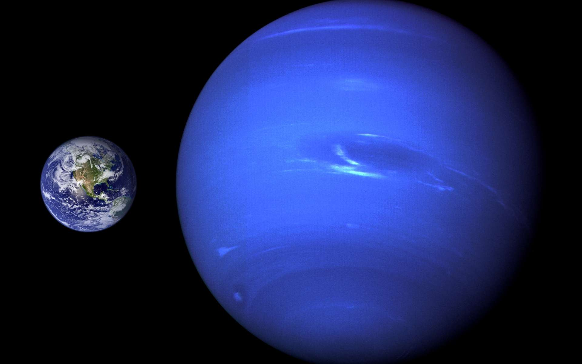Une comparaison entre la taille de la Terre et celle de Neptune. On connaît bien mieux l'intérieur de notre planète que celle de la géante. On a toutefois quelques idées sur ce qui peut se cacher sous les couches de nuages photographiées ici par la sonde Voyager. Neptune pourrait ainsi contenir de « l'acide d'Hitler », tout comme Uranus. © Nasa