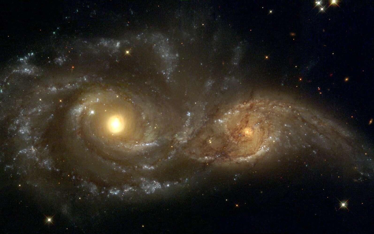 L'archéologie galactique révèle le passé de la Voie lactée, notamment ses collisions. Image obtenue par le télescope spatial Hubble montrant les galaxies NGC 2207 et IC 2163 en interaction gravitationnelle. © Nasa