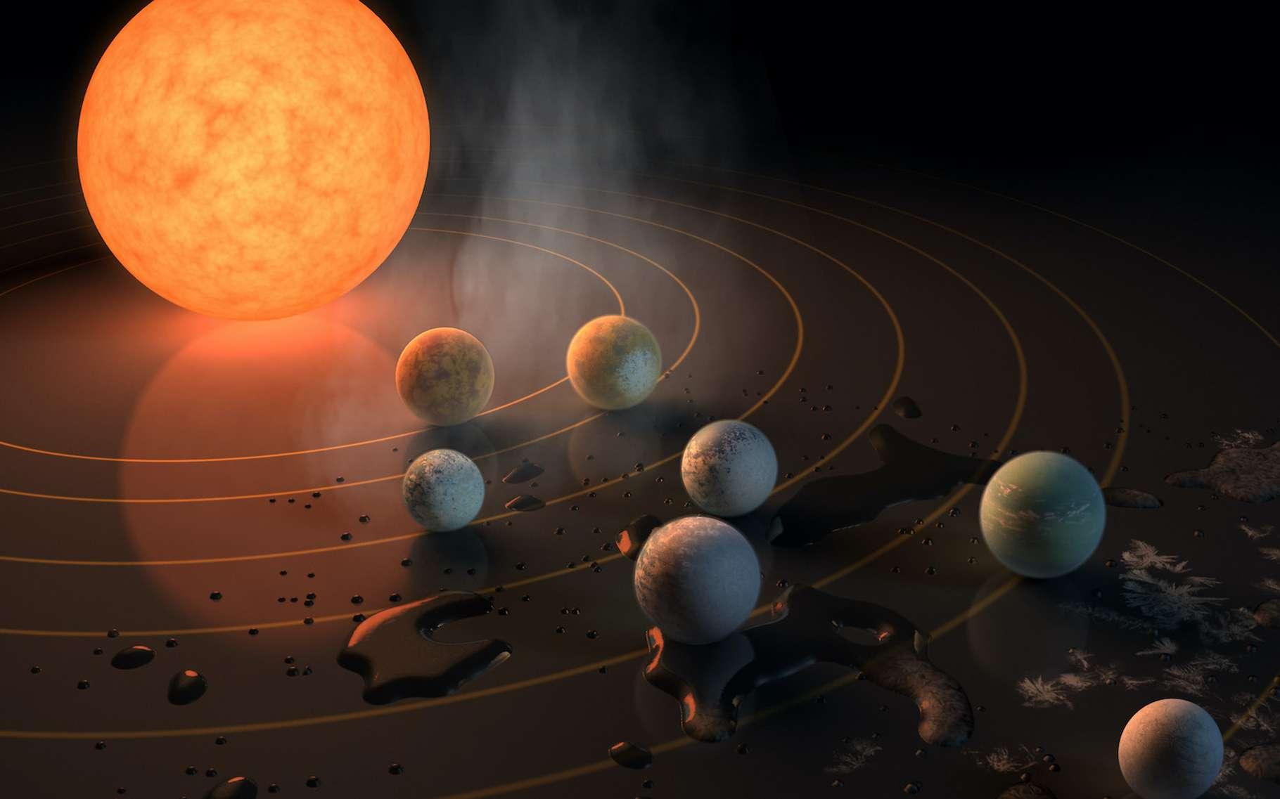 Sur cette vue d'artiste, le système planétaire Trappist-1, le seul découvert pour l'instant comptant presque autant de planètes que notre Système solaire. Selon des chercheurs de l'Institut Niels Bohr (Danemark), il s'agirait là d'une condition à l'apparition de la vie. © Nasa