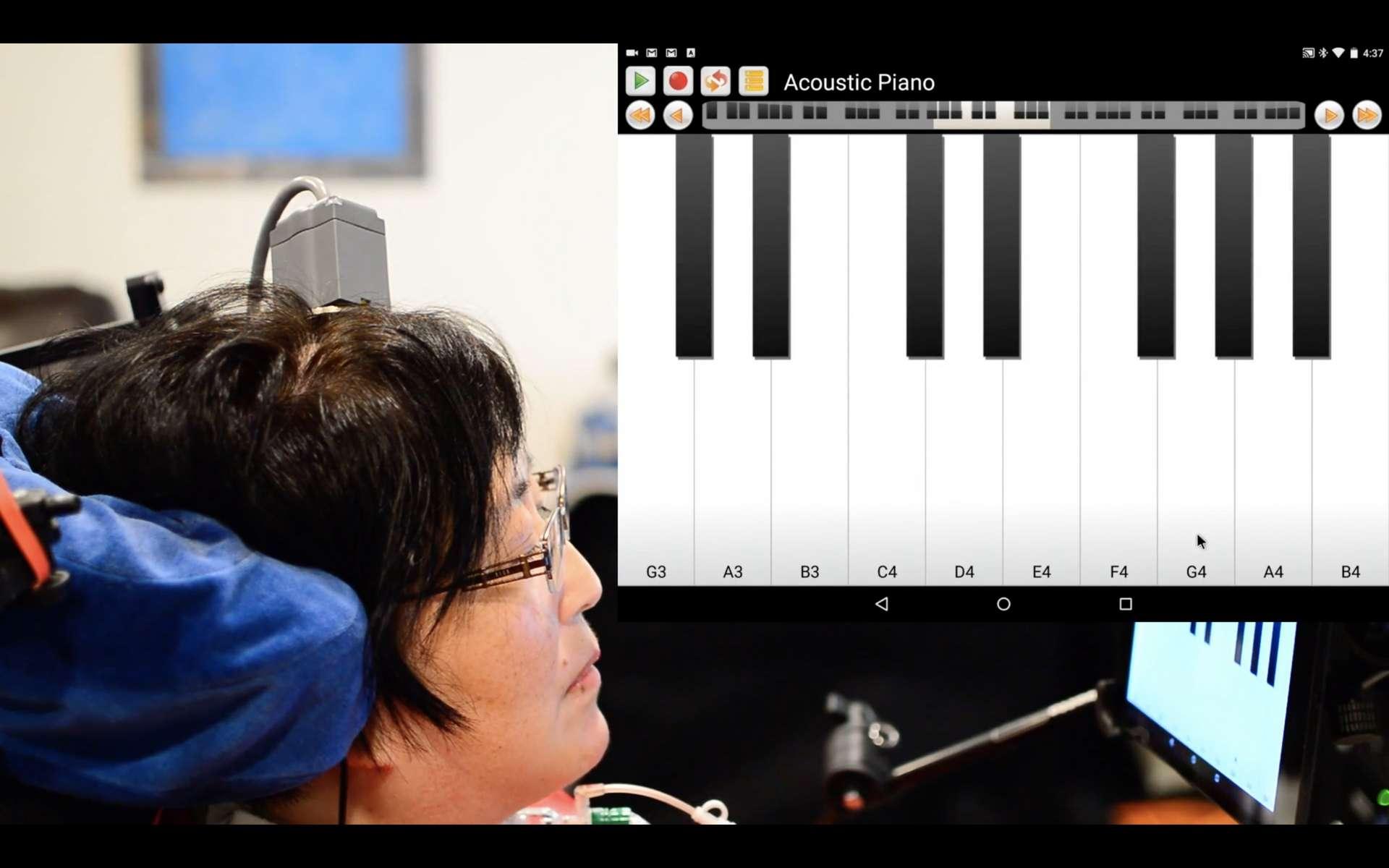 L'une des participantes à l'essai BrainGate 2, musicienne de formation, a même pu jouer quelques notes de « l'Ode à la joie » de la Symphonie nᵒ 9 de Beethoven. © BrainGate Collaboration