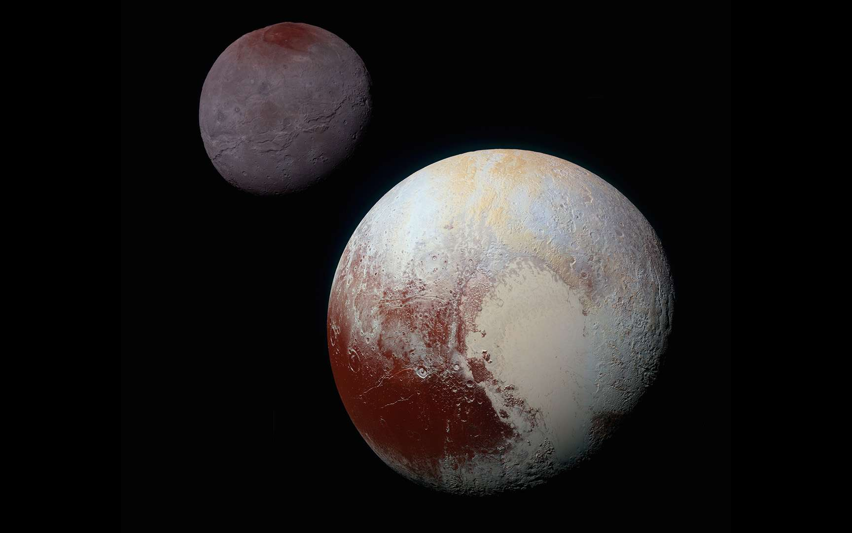 Vue globale de Pluton et Charon lors de la visite historique de la sonde New Horizons. © Nasa, SwRI, JHUAPL