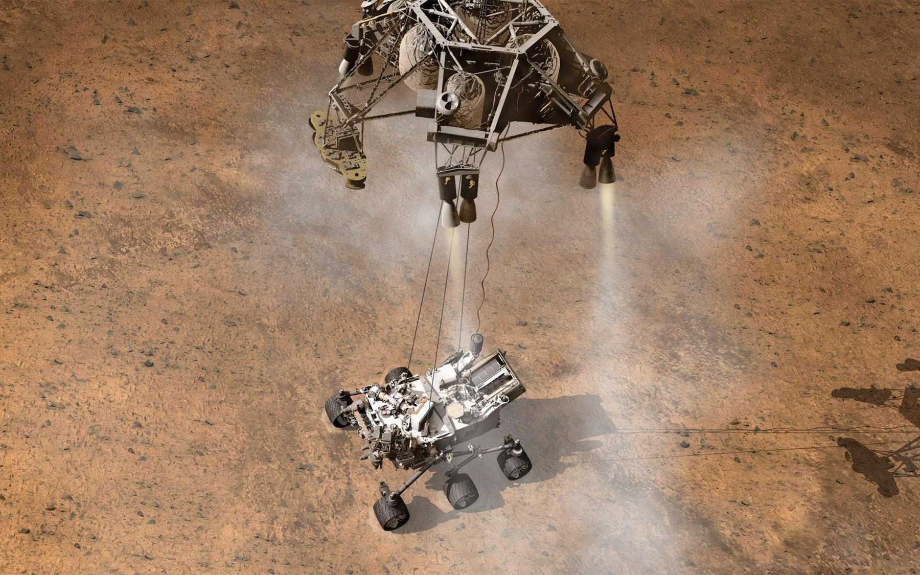 Trois sondes ne seront pas de trop pour surveiller l'atterrissage de Curiosity qui terminera sa descente accroché à une sorte de grue qui le posera sur le sol. © JPL-Caltech, Nasa