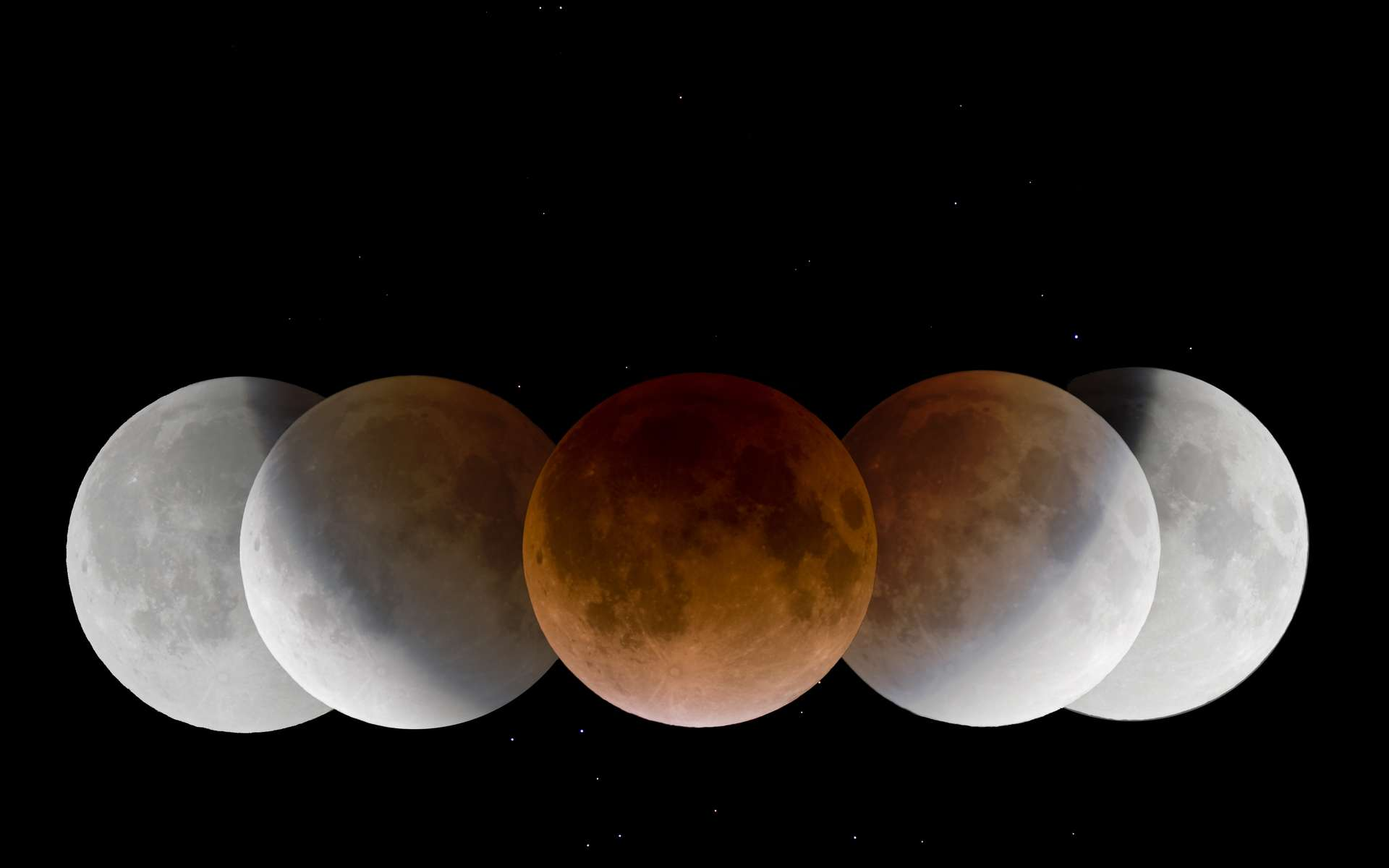 Lors d'une éclipse de Lune, notre satellite prend une couleur cuivrée. © Wang, Letian, APOD