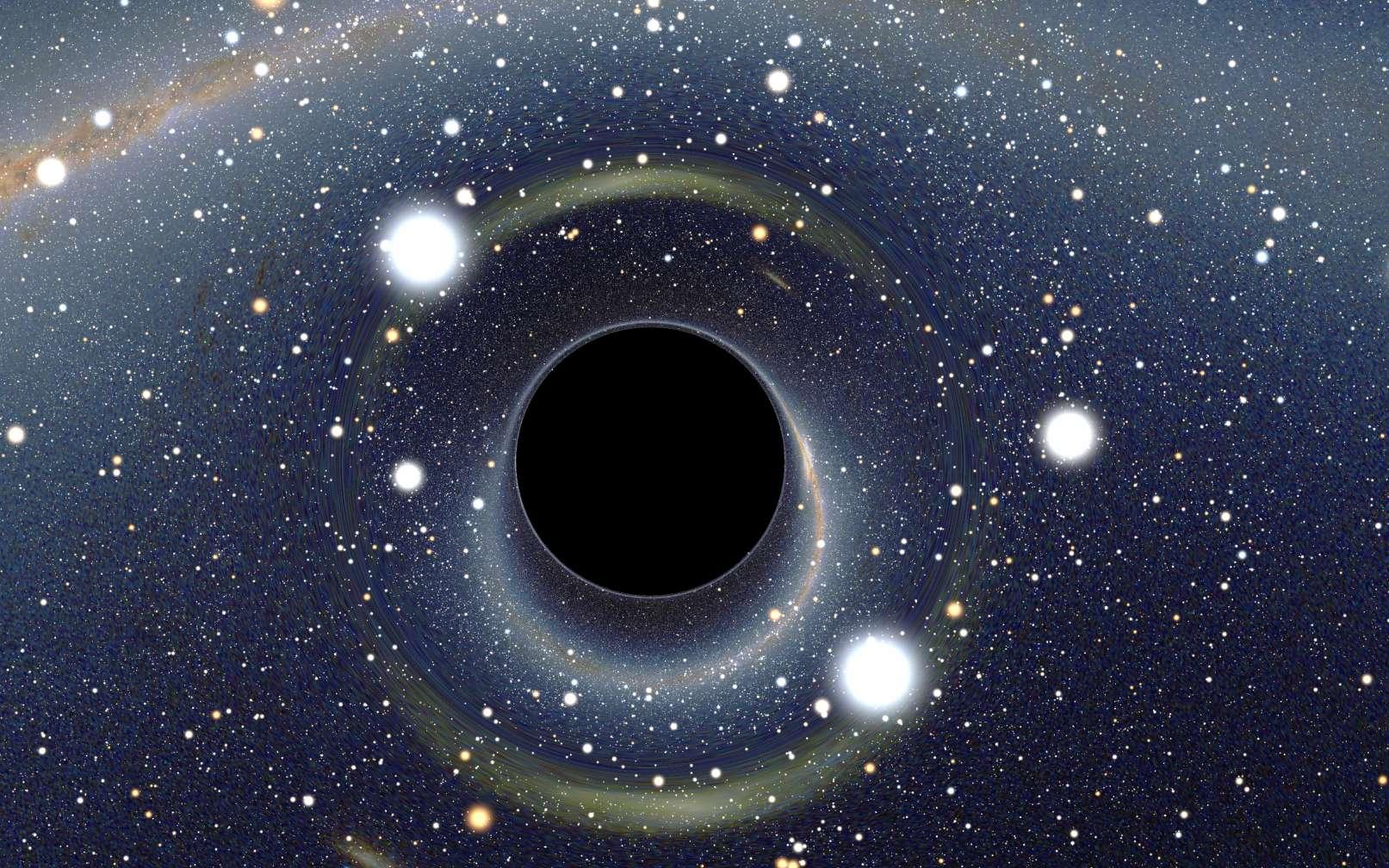 Image simulée d'un trou noir stellaire qu'un observateur situé à une dizaine de kilomètres (neuf fois le rayon du trou noir) verrait et dont l'image se dessine en direction du Grand Nuage de Magellan par des effet de lentille gravitationnelle. © Alain Riazuelo, CC by-sa 2.5