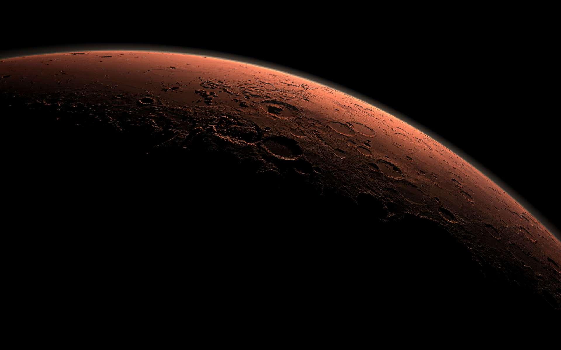 Y aura-t-il bientôt une ville sur Mars ? C'est en tout cas ce qu'envisagent les Émirats arabes unis. Ici, le cratère Gale sur le limbe de Mars, au lever du jour. © Nasa