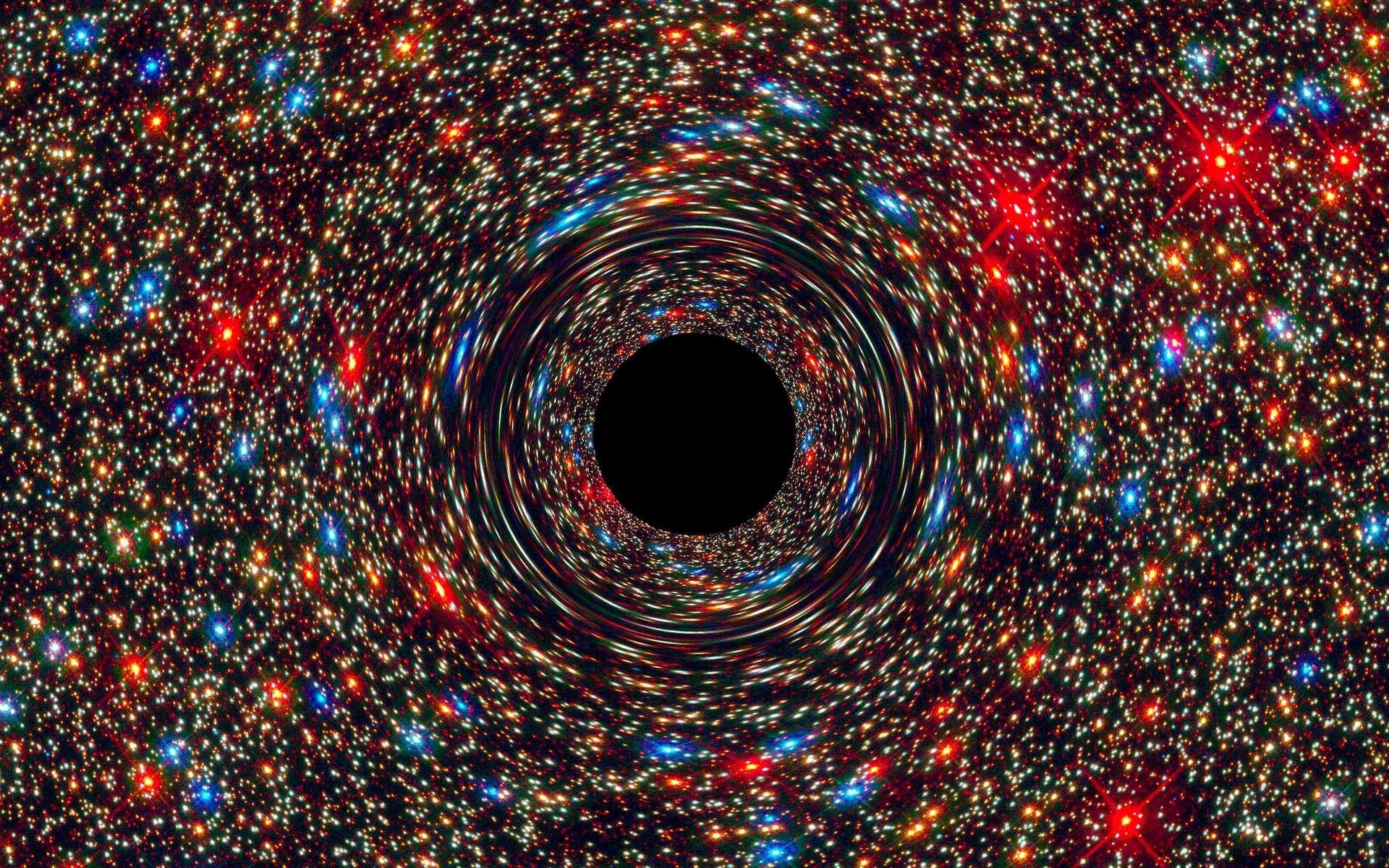 Image d'un trou noir supermassif au centre d'une galaxie simulée par ordinateur. Le rond noir figure l'horizon des événements, limite au-delà de laquelle toute matière ne peut plus s'échapper. Plus la masse de ce puits gravitationnel est grande, plus l'espace et le temps sont déformés, ce qui produit cet effet de miroir déformant sur les étoiles à l'arrière-plan. © Nasa, Esa, C.-P. Ma (University of California, Berkeley), J. Thomas (Max Planck Institute for Extraterrestrial Physics, Garching)