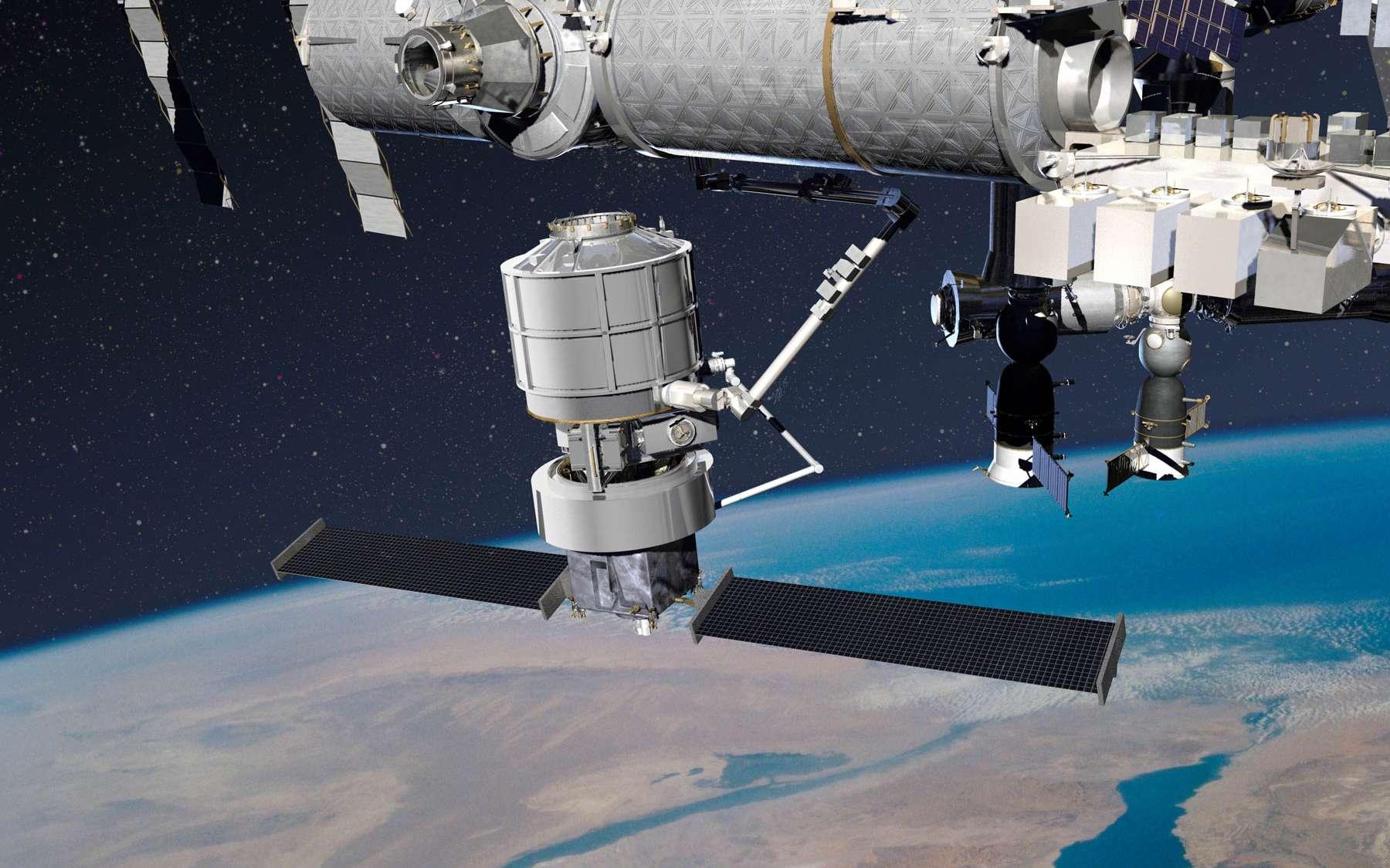 L'Exoliner amené à l'ISS par le Jupiter et amarré au complexe orbital par le bras de l'ISS. © Lockheed Martin