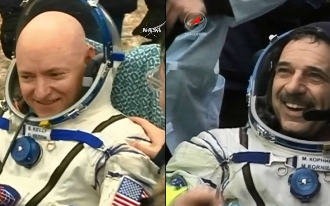Scott Kelly et Mikhail Kornienko viennent de retrouver le sol de notre planète, après une année à tourner autour d'elle. © Nasa TV