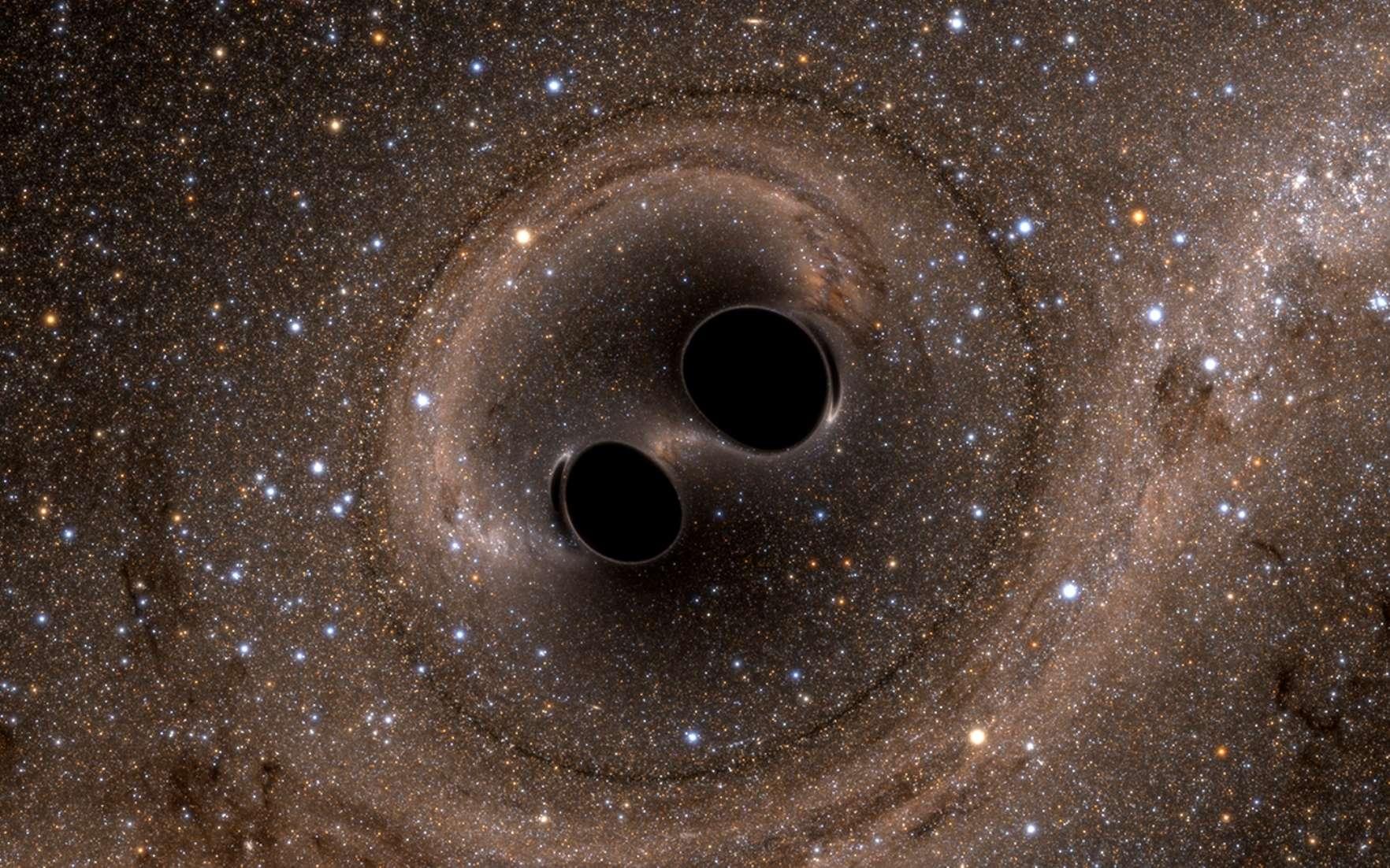 Les ondes gravitationnelles seront-elles bientôt détectables grâce aux pulsars ? Ici, deux trous noirs supermassifs sur le point de fusionner dans une simulation numérique réaliste sur ordinateur. © SXS
