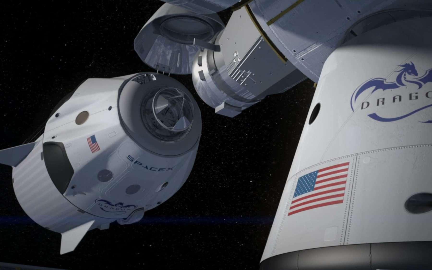 SpaceX abandonne l'idée de faire atterrir sa capsule Dragon avec des rétrofusées. Ici, une image de synthèse de la version habitée de la capsule Dragon V2, en approche de l'ISS. © SpaceX