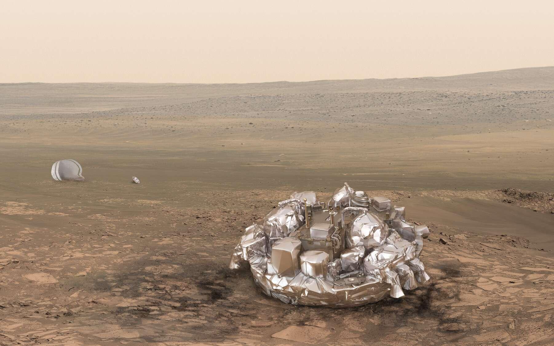 Vue d'artiste de l'atterrisseur Schiaparelli posé sur le sol martien et tel que l'on souhaiterait qu'il soit dans la réalité. © ESA