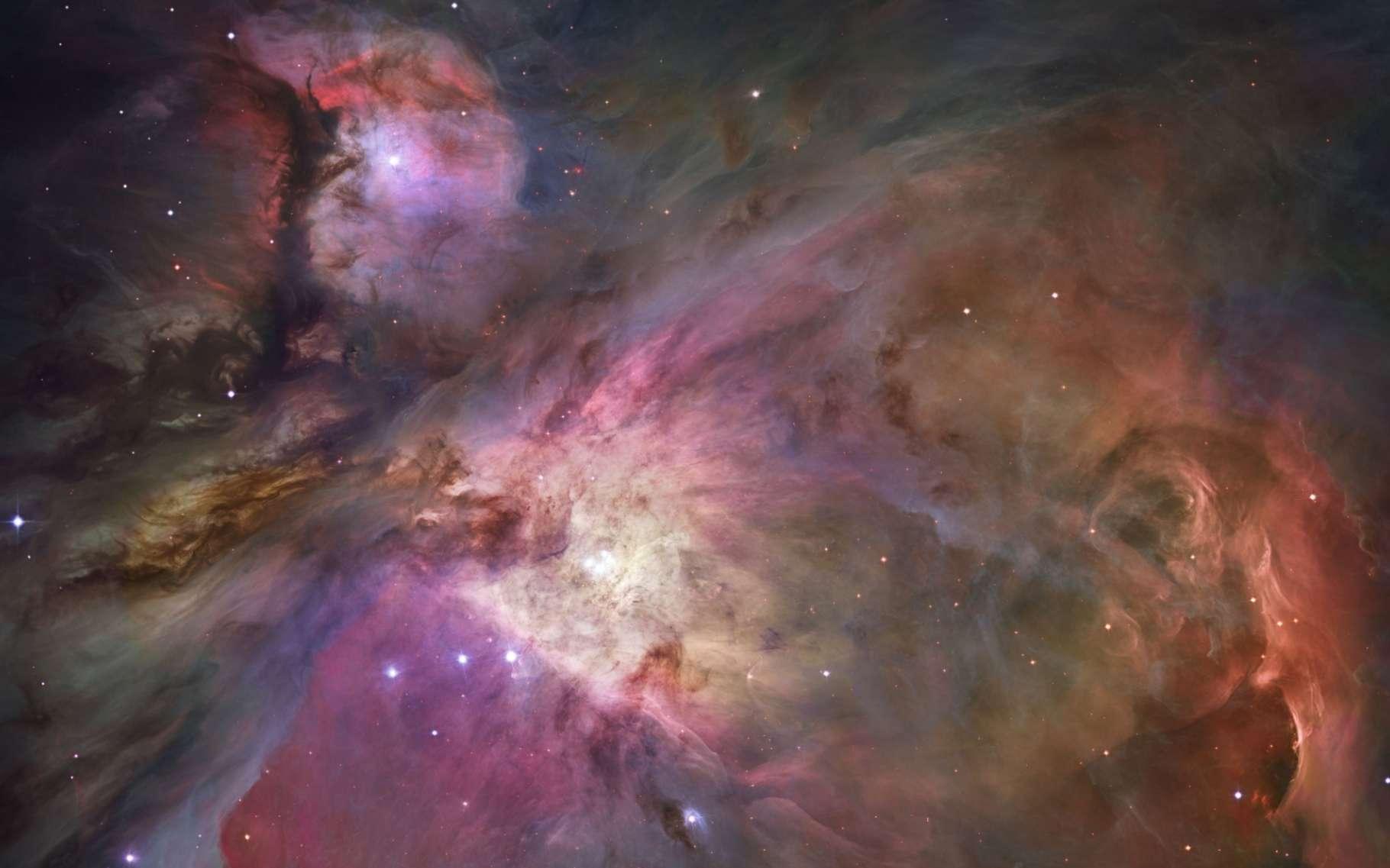 La nébuleuse d'Orion, représentée par une mosaïque d'images saisies par le télescope spatial Hubble en 2006. Dans ces immenses nuages de gaz, qui renferment de l'eau et d'autres molécules, se forment des étoiles et leurs cortèges de planètes. © Nasa, ESA