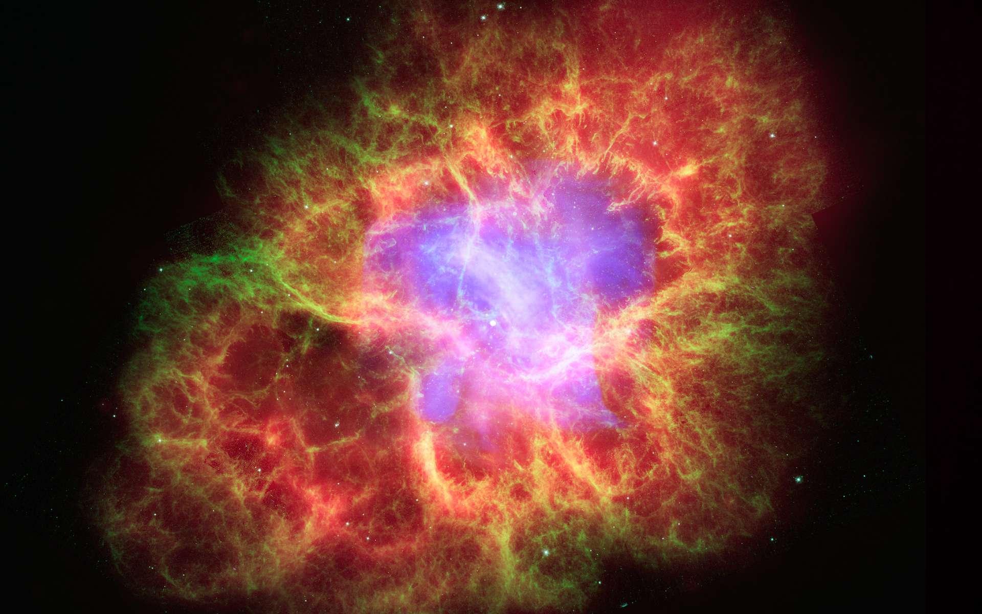 Lorsqu'une étoile explose en supernova, elle libère des éléments chimiques et les diffuse dans le milieu interstellaire. Ici, la nébuleuse du Crabe (dans la constellation du Taureau), un célèbre rémanent de supernova. © Rayons X : Nasa/CXC/J. Hester (ASU) ; Optique : Nasa/Esa/J. Hester et A. Loll (ASU) ; Infrarouge : Nasa/JPL-Caltech/R. Gehrz (Univ. Minn.), Wikimedia Commons, DP