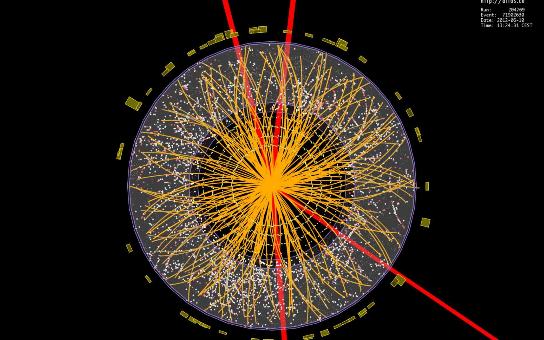 Cette image montre, reconstituée à l'ordinateur après filtrage de bien des évènements parasites, la désintégration d'un boson de Brout-Englert-Higgs au cœur du détecteur Atlas du LHC. Le boson a donné quatre particules chargées, des muons dont les trajectoires ont été colorées en rouge. © Cern, Collaboration Atlas