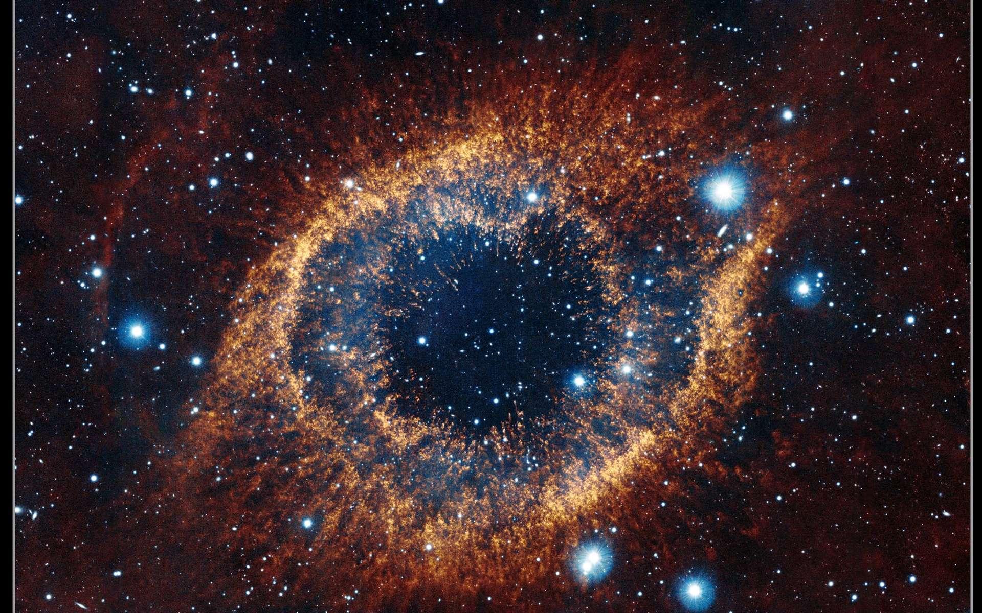 Image de la nébuleuse de l'Hélice réalisée en infrarouge par le télescope Vista. © ESO