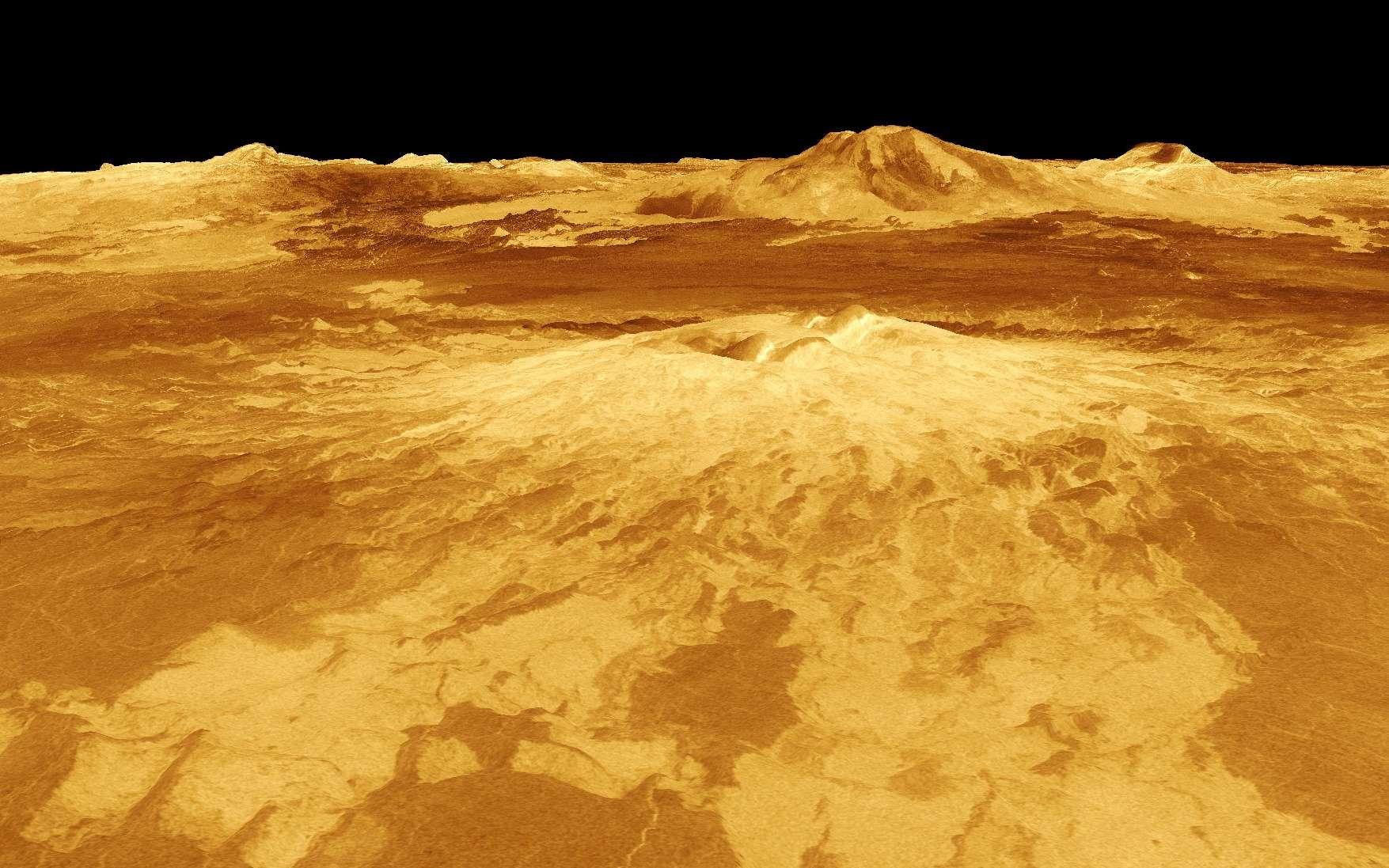 Sur cette image, la topographie de Vénus dérivée des données de Magellan montre Idunn Mons. Son altitude de 2,5 kilomètres a été exagérée par rapport à la plaine environnante qui s'étend sur 200 kilomètres environ. Les couleurs, reliées au flux de chaleur, indiquent un changement de composition au sommet du volcan. © Nasa-ESA