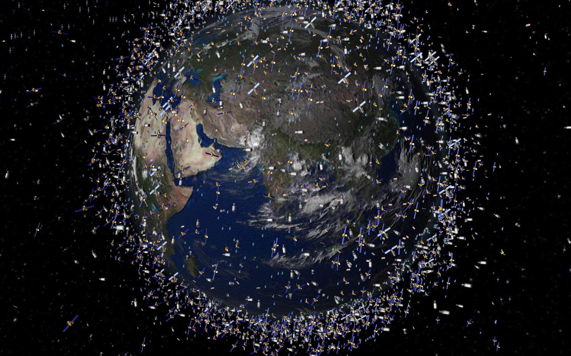 Cette illustration sur les débris spatiaux en orbite, sans mise à l'échelle, nous rappelle que les débris qui tournent autour de la Terre, notamment en orbites basses, commencent à poser de sérieux problèmes tant pour les engins spatiaux (satellites, station spatiale, véhicules spatiaux) que pour les astronautes. © Esa, 2009
