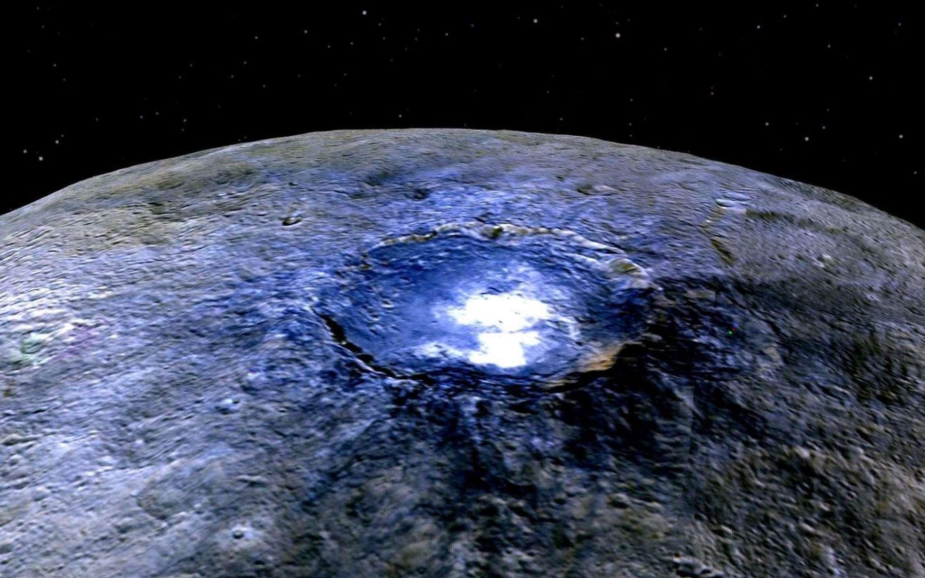 Image en fausses couleurs de Cérès. Acquise depuis une altitude de 4.400 kilomètres, elle renseigne les scientifiques sur les différents composants de la surface de cette planète naine. Cette couleur bleue est généralement associée à des matériaux brillants, comme des sulfates. Plus de 130 autres endroits de ce type ont été recensés sur cette planète naine. © Nasa, JPL-Caltech, UCLA, MPS, DLR, IDA