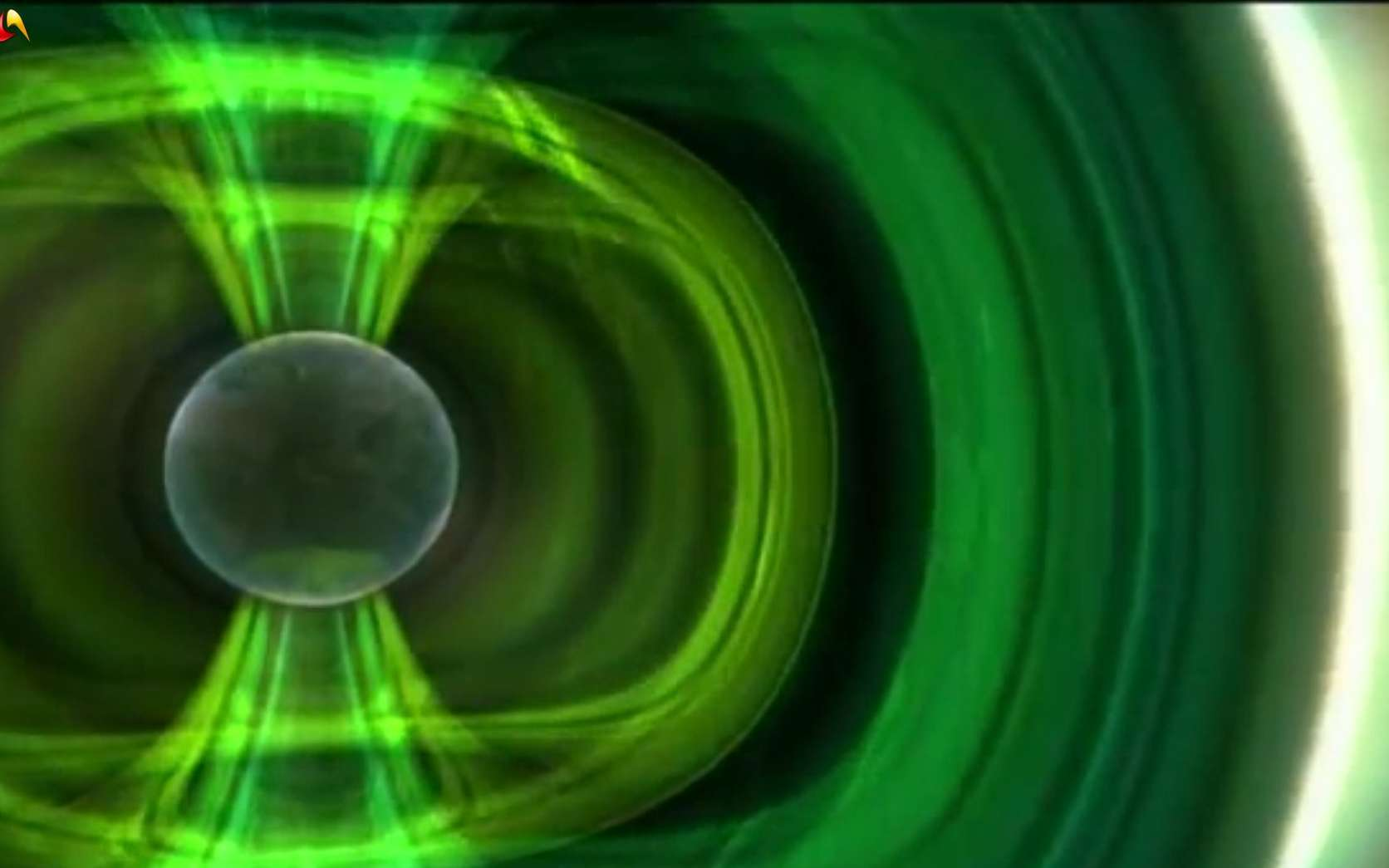 Une représentation stylisée du champ magnétique de la Terre qui évite aux particules du vent solaire de pénétrer dans l'atmosphère (si ce n'est dans les régions polaires pour y dessiner des aurores). © Discovery Science