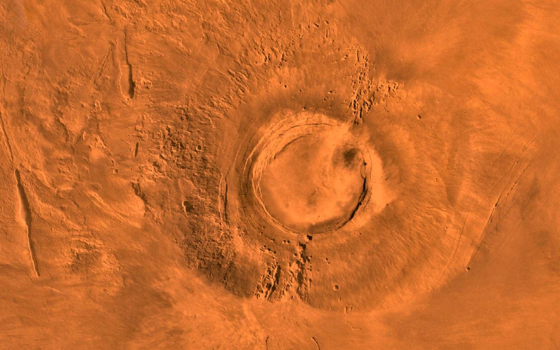 Cette mosaïque d'images numériques du plateau Tharsis de Mars montre le volcan éteint Arsia Mons. Elle a été assemblée à partir d'images que Viking 1 a pris au cours de sa carrière, de 1976 à 1980. Arsia Mons, l'un des trois volcans géants qui surmontent le plateau de Tharsis. Il culmine à 17 km et sa caldeira est bien plus importante que celle d'Olympus Mons puisqu'elle mesure 120 km de diamètre. © Nasa, JPL, USGS