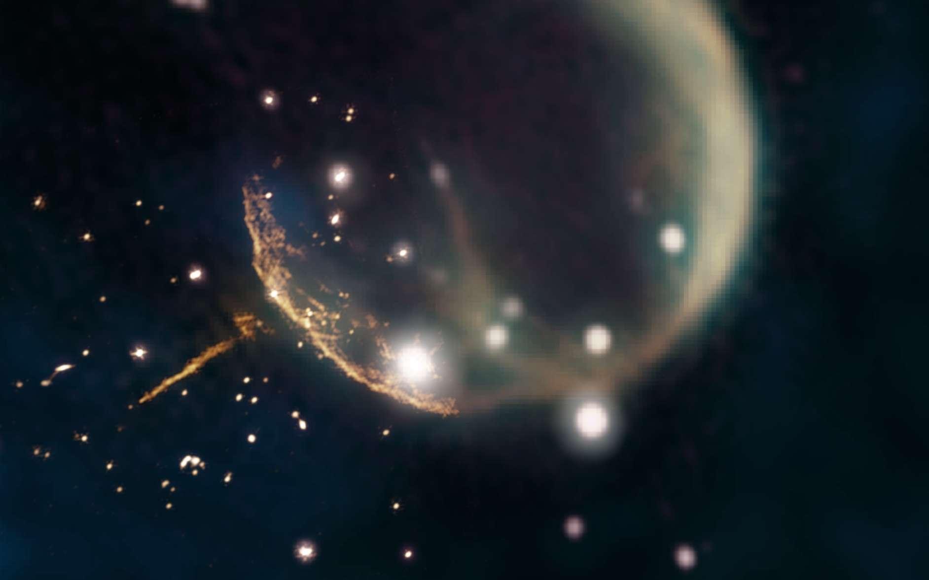 Le reste de la supernova CTB 1 ressemble à une bulle fantomatique sur cette image, qui associe les nouvelles observations à 1,5 gigahertz du radiotélescope Very Large Array ou VLA (orange, proche du centre) à des observations plus anciennes provenant du Canadian Galactic Plane Survey de l'observatoire fédéral de radioastrophysique (1,42 gigahertz, magenta et jaune ; 408 mégahertz, vert) et données infrarouges (bleu). Les données VLA révèlent clairement la trace droite brillante du pulsar J0002 + 6216 et le bord incurvé de la coquille du reste de la supernova. © Image composite de Jayanne English, Université du Manitoba, utilisant les données de NRAO/F. Schinzel et al., DRAO/Canadian Galactic Plane Survey et Nasa/Iras