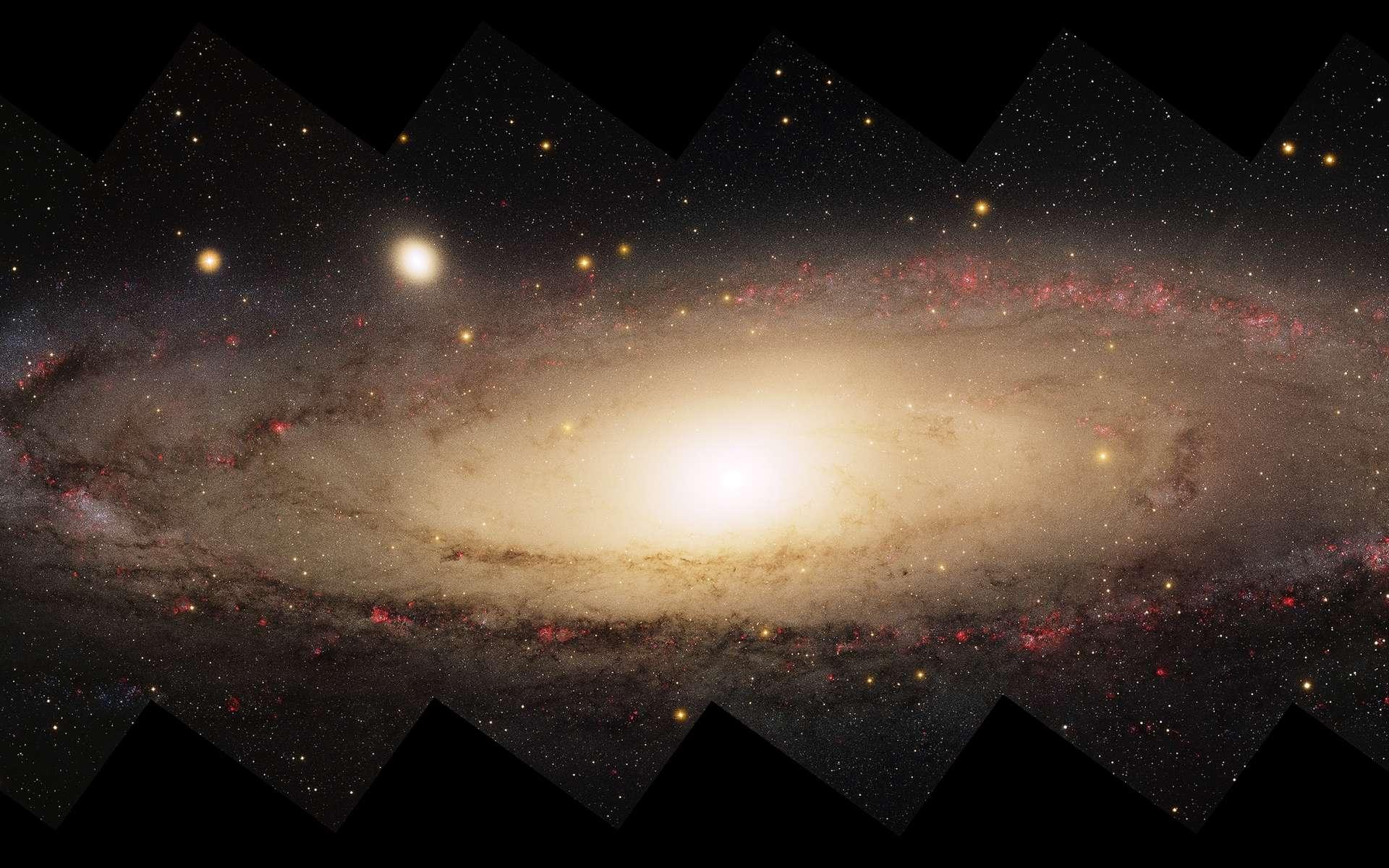 La galaxie d'Andromède, notre voisine située à quelque 2,5 millions d'années-lumière de notre Voie lactée, apparaît comme un véritable cannibale galactique, boulimique, dévorant d'autres galaxies. © © Local Group Survey Team and T.A. Rector (University of Alaska Anchorage), NOAO