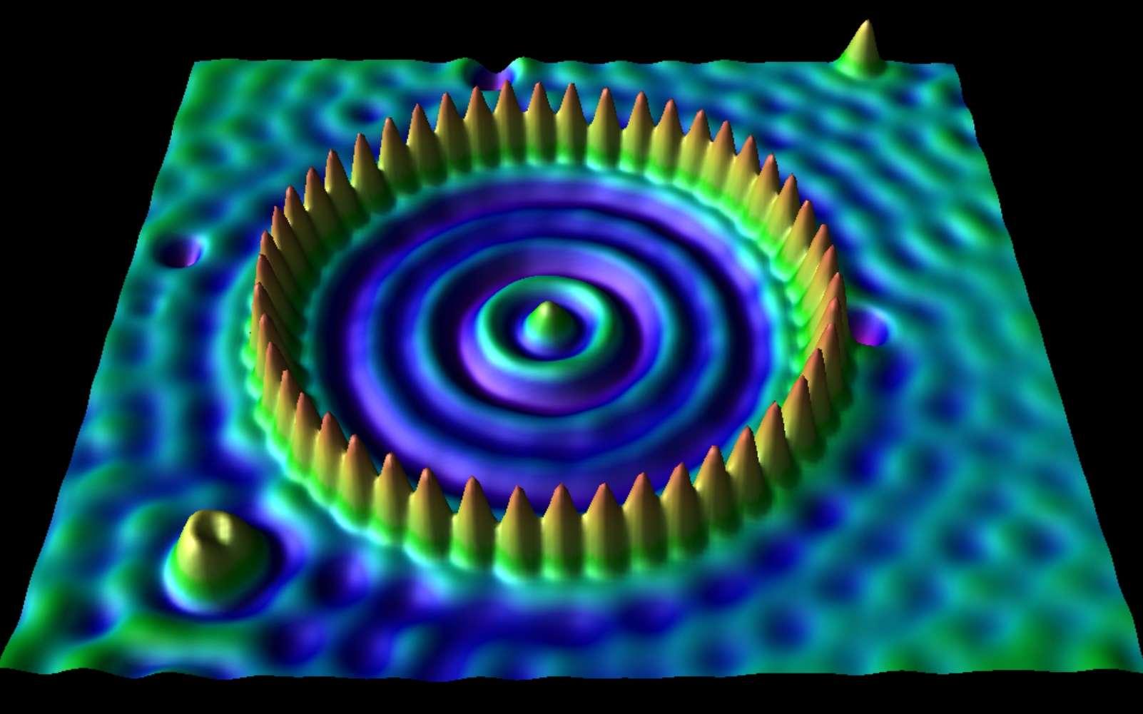 Cette image montre à l'aide d'un microscope à effet tunnel une surface de cuivre d'environ 5 nanomètres où les atomes de cuivre ont été confinés à l'intérieur d'un enclos de 48 atomes de fer. © IBM Almaden Visualization Lab
